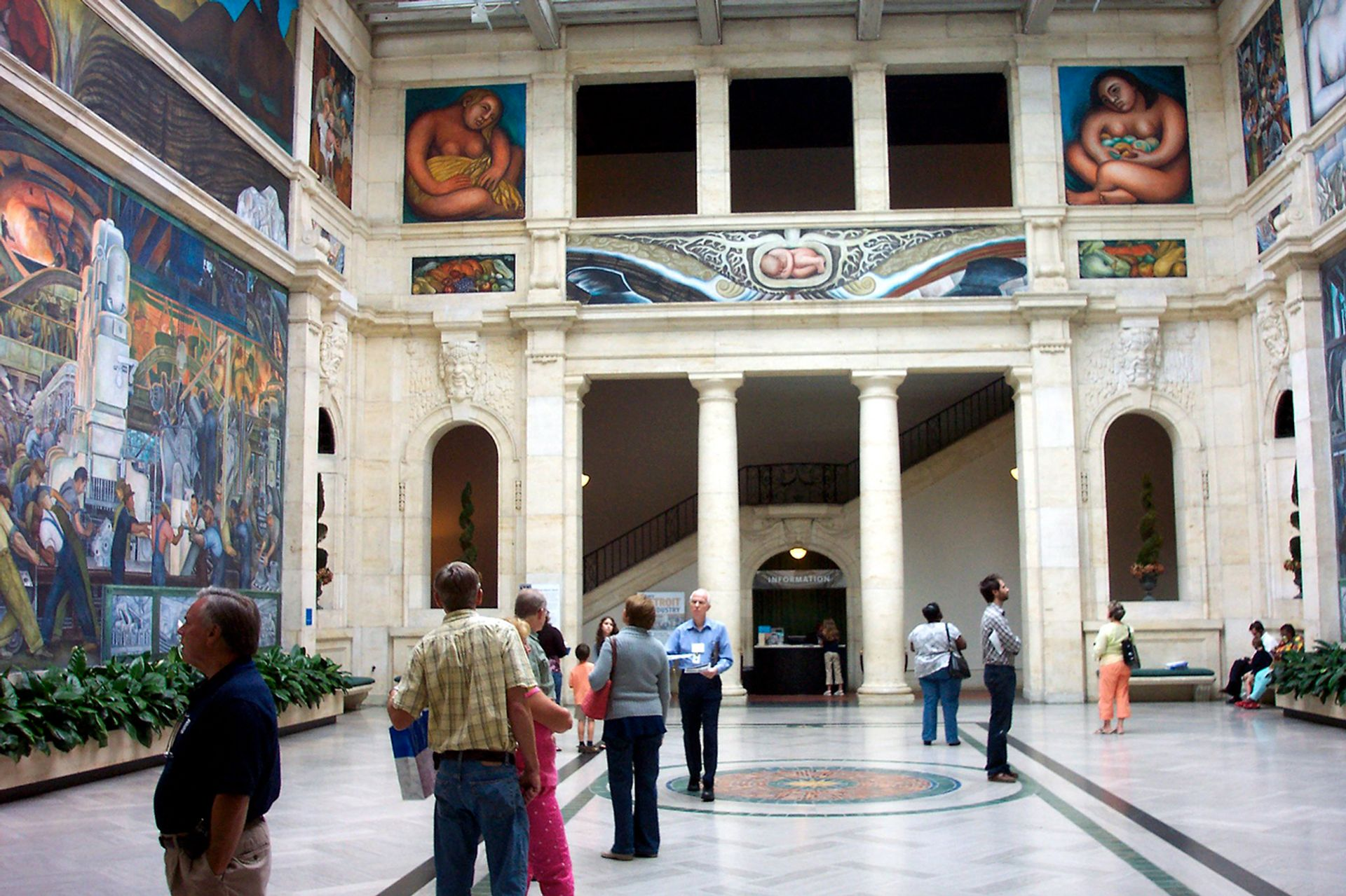 A gallery at the Detroit Institute of Arts featuring frescoes by Diego Rivera