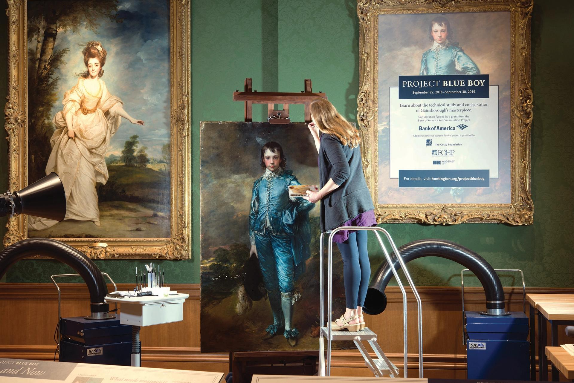 Conservator Christina O'Connell at work on The Blue Boy in one of the Huntington's galleries—more than 200,000 visitors witnessed the conservation in progress in 2018-19 Courtesy of The Huntington Library, Art Museum and Botanical Gardens