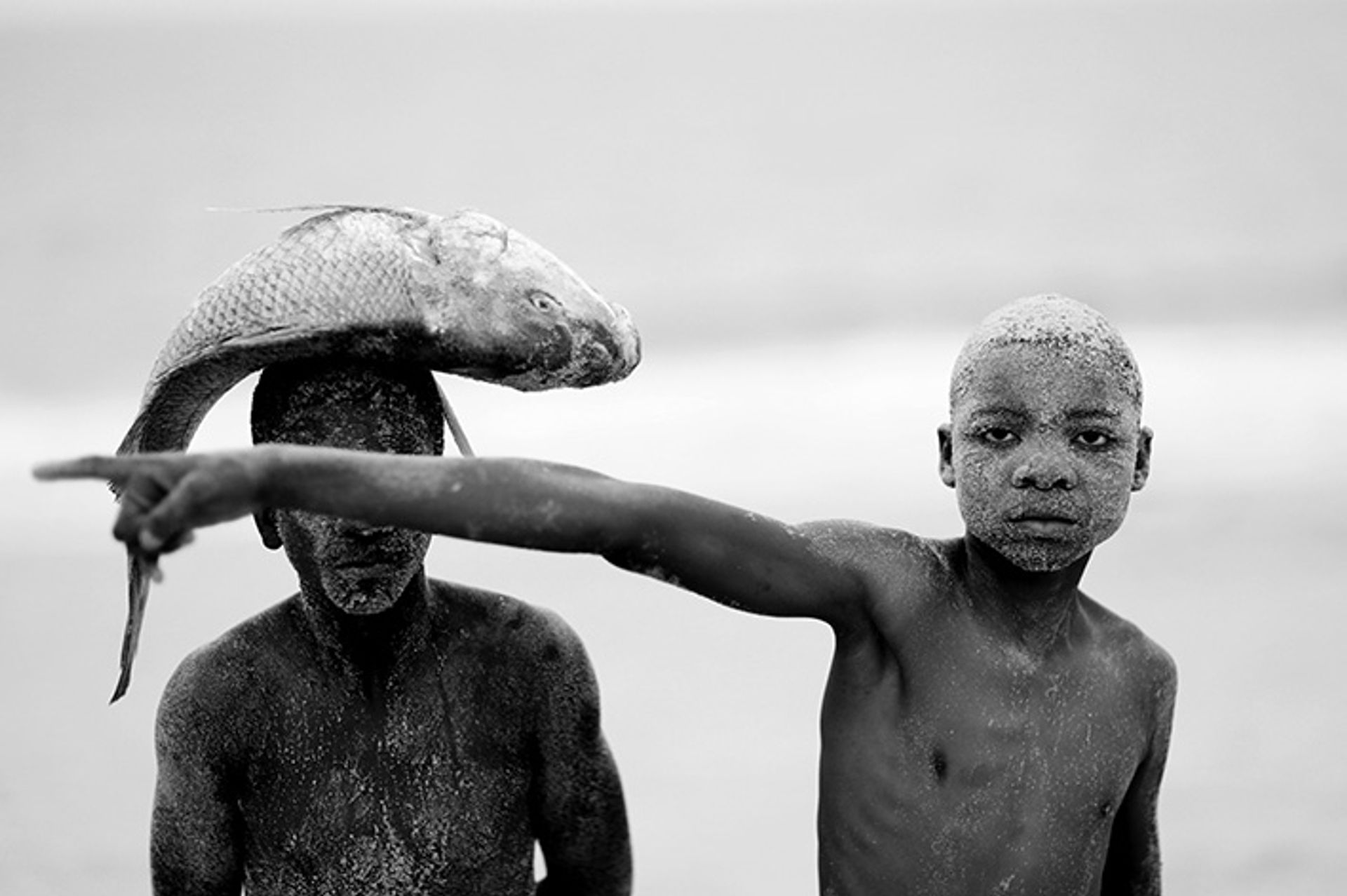 Mario Macilau, Two Boys with a Fish, from the series Faith (2018) Courtesy of the artist