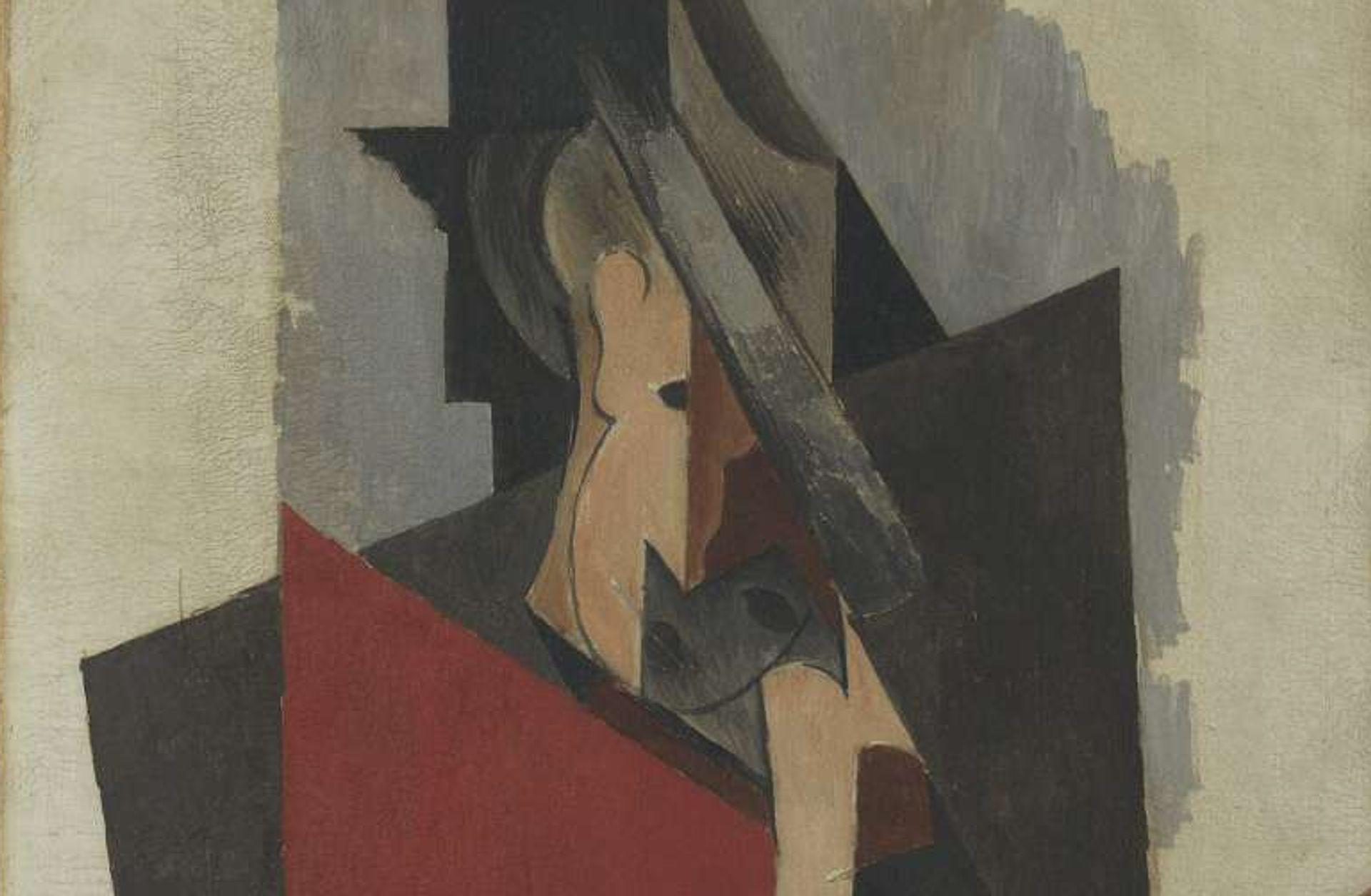 Detail of Pablo Picasso, Hombre sentado (1917) showing deep cracks Photo by Gasull Fotografia