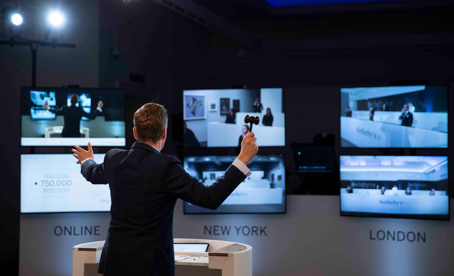 Auctioneer Oliver Barker takes bids from phones and online bidders Courtesy of Sotheby's