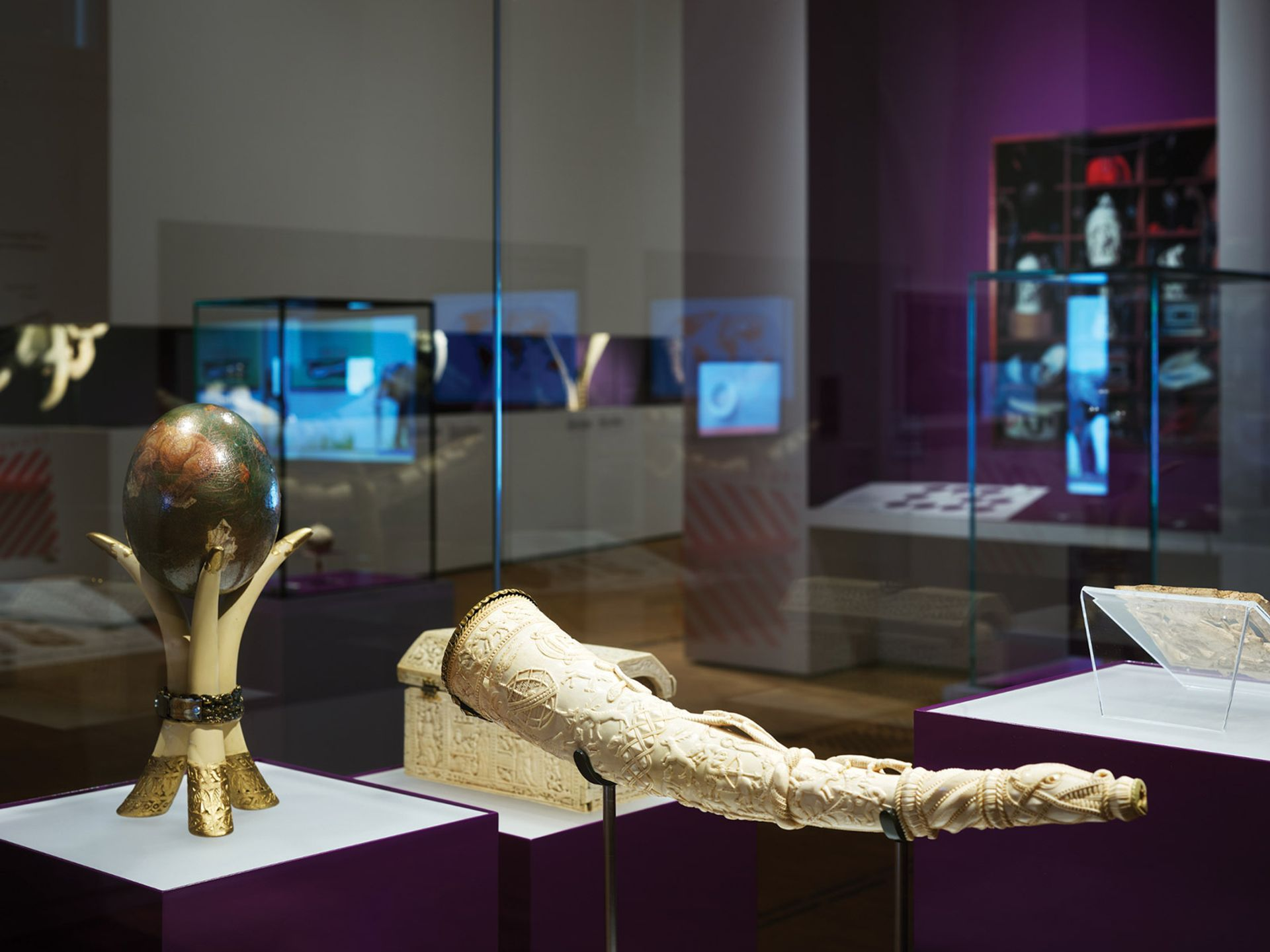 Fine ivory objects are shown alongside chilling images reflecting the scale and violence of elephant poaching. Here, a hunting horn from Sapi, Sierra Leone (around 1490 to 1530) and a painted ostrich egg on a stand made of elephant tusks from Botswana (before 2006) Photo: Ronny Hartmann/AFP via Getty Images