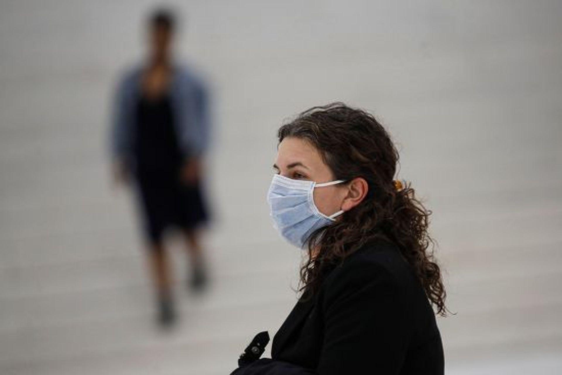 Face masks are in short supply across the globe. John Minchillo/AP/Shutterstock