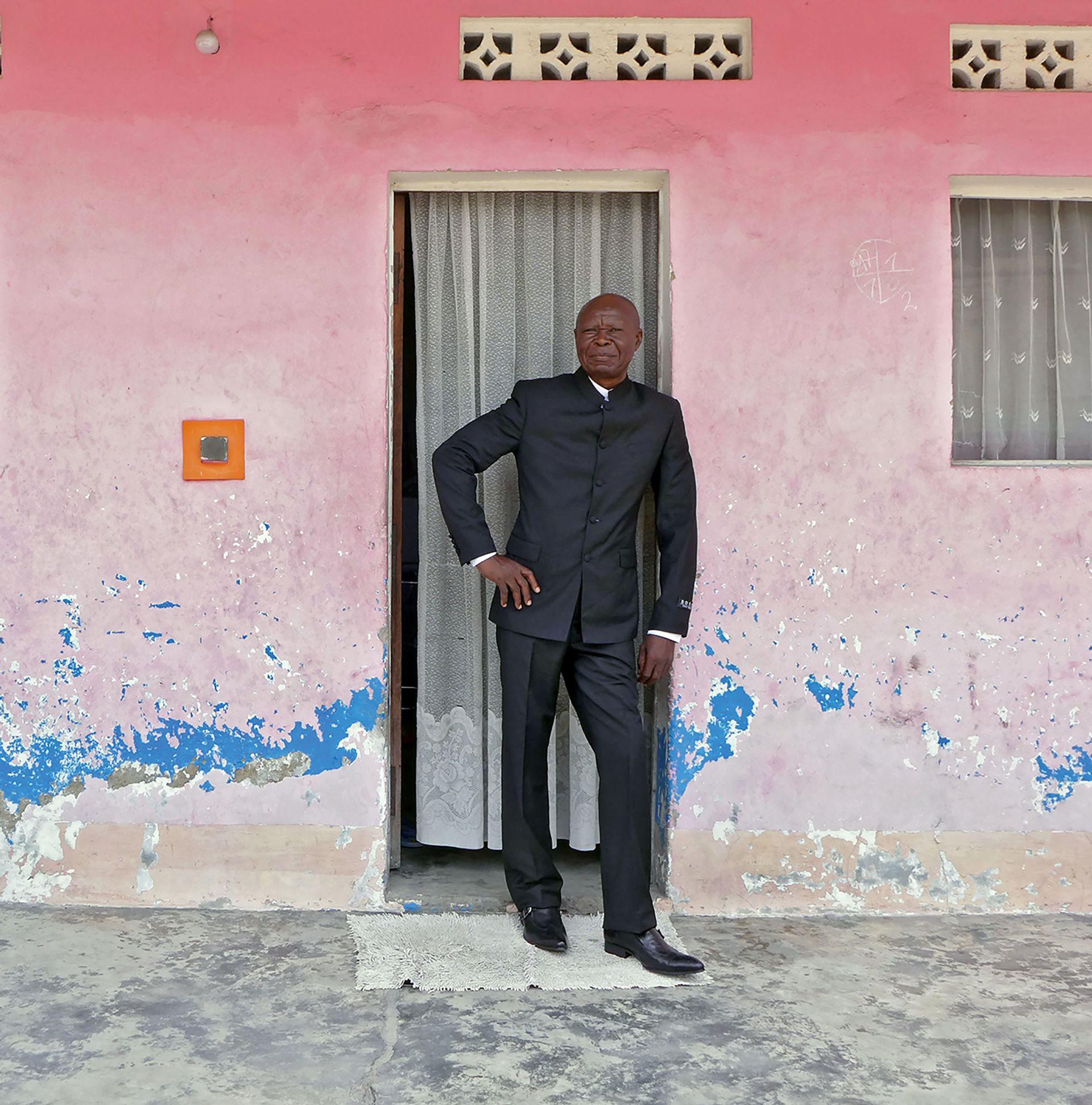 Bodys Isek Kingelez outside his Kinshasa home in 2014 Courtesy of André Magnin, Paris; Photo: Fredi Casco.