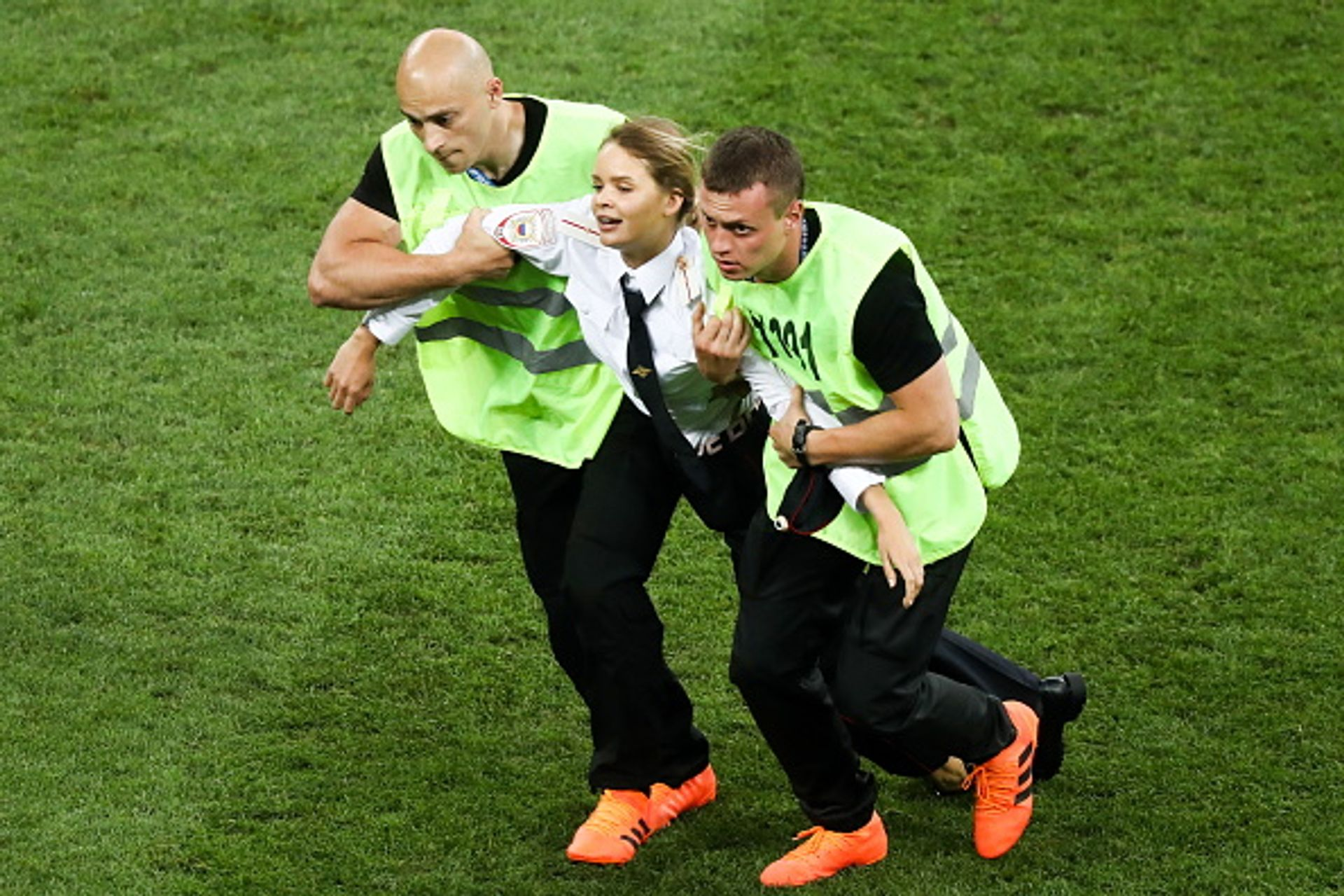 Security guards detain one of the pitch invaders during the 2018 FIFA World Cup final match at Luzhniki stadium in Moscow Stanislav Krasilnikov/TASS via Getty Images