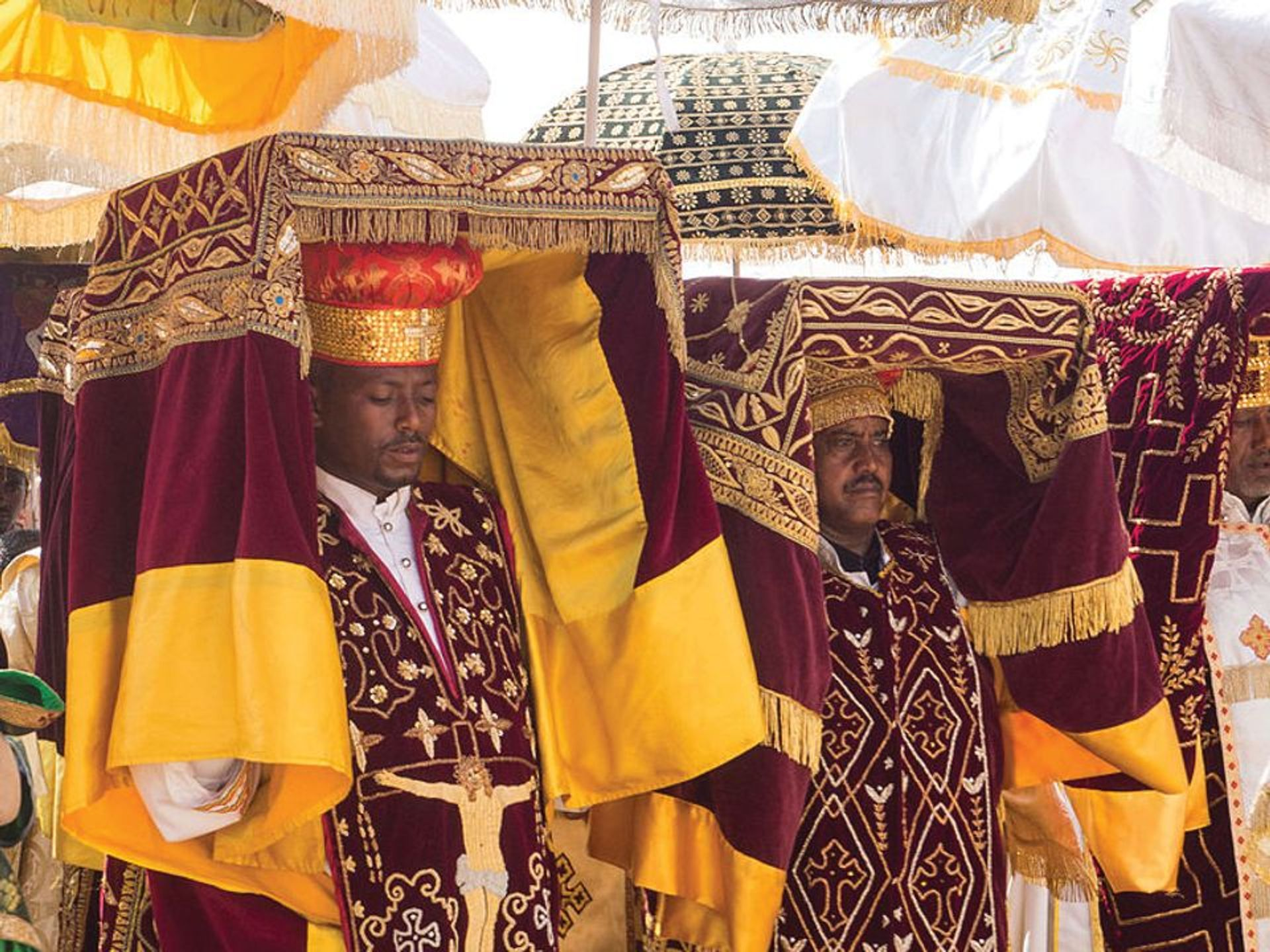 Priests in Addis Ababa carrying covered tabots on their heads during a celebration of the Epiphany © Jean Rebiffé