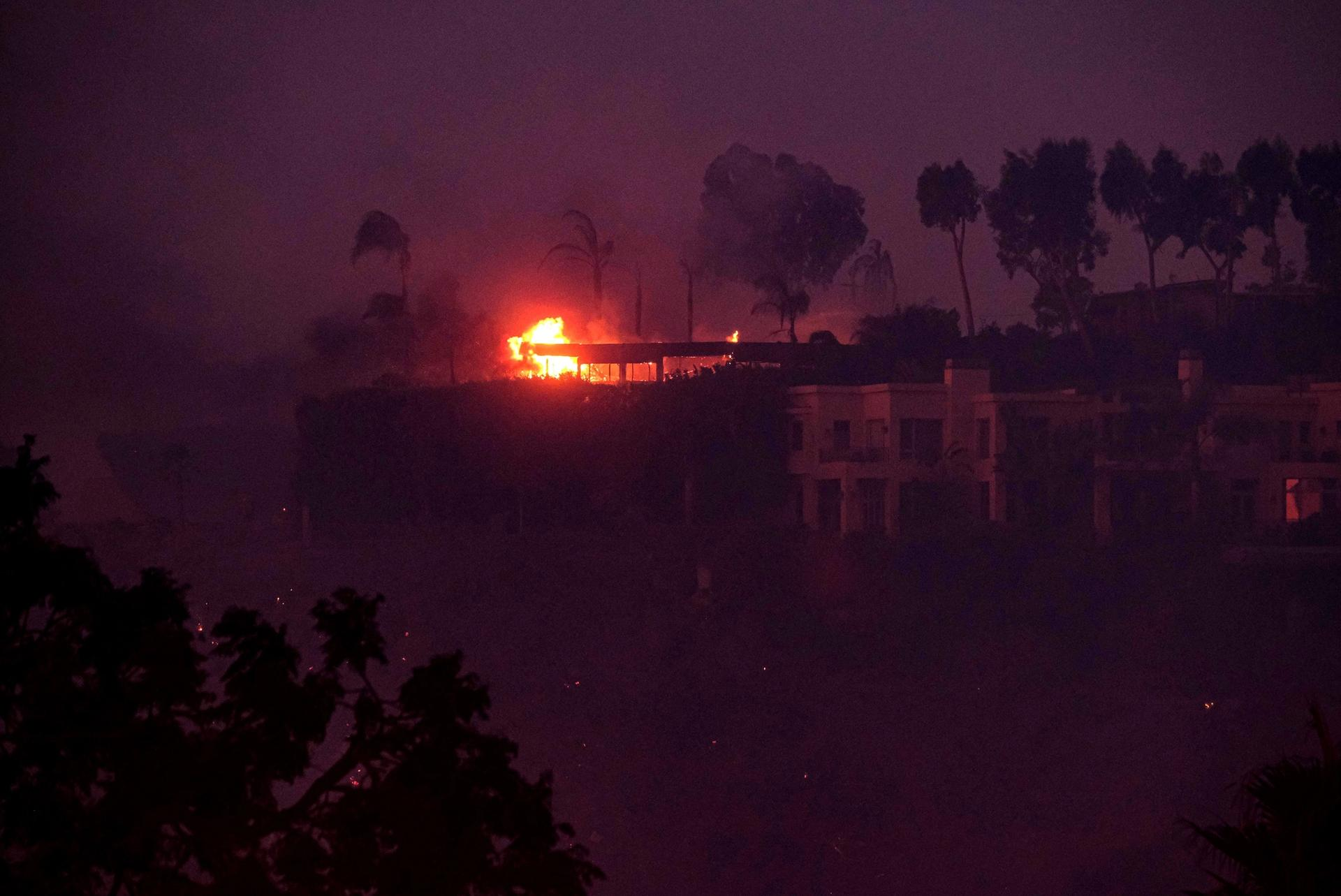 Wildfires burn near the 405 freeway and the Getty Center in Los Angeles on 30 October. Jason Ryan/ ZUMA Wire/ Shutterstock