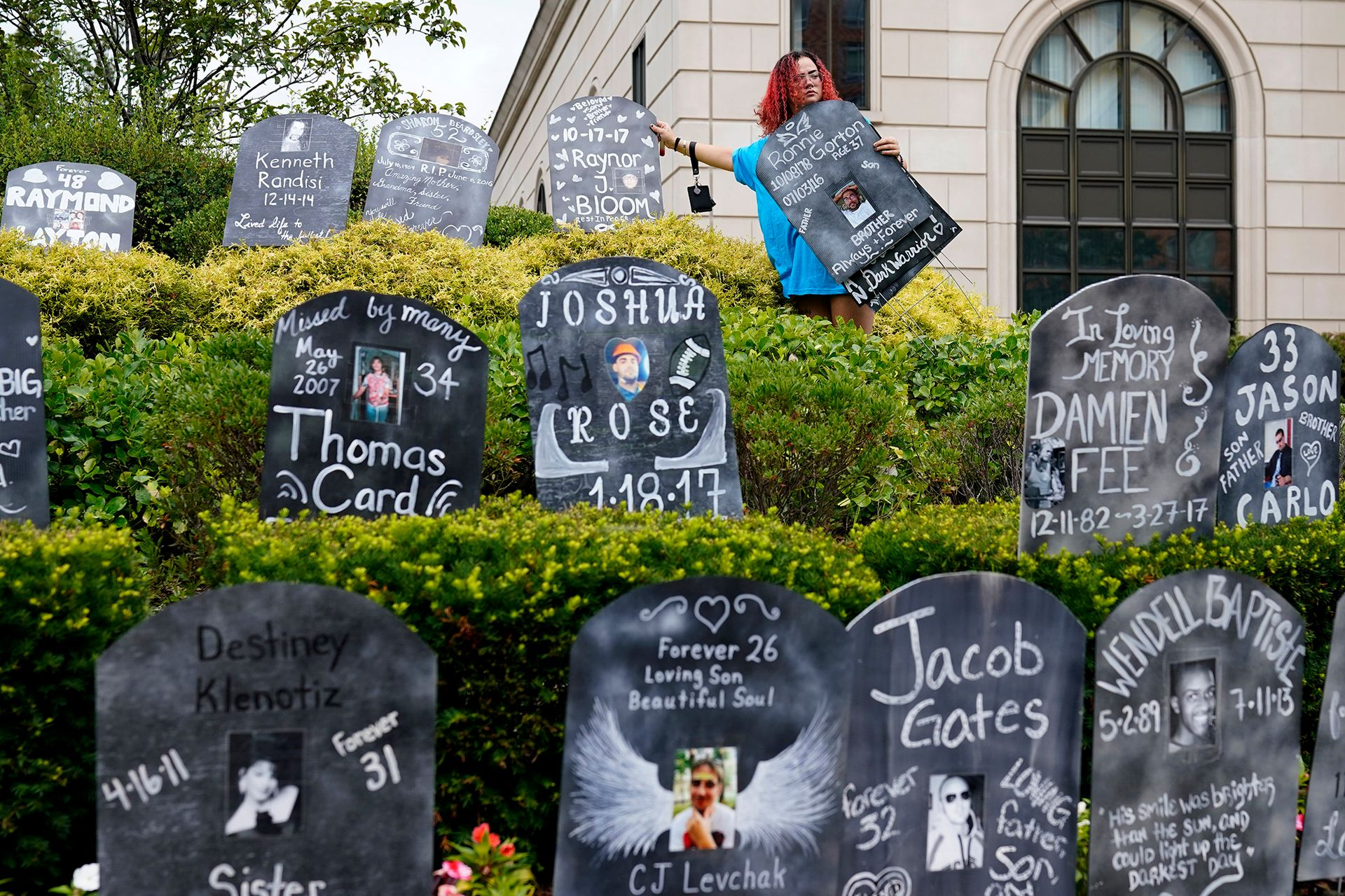 Cardboard tombstones honouring opioid overdose victims, arrayed by protesters outside a federal courthouse in White Plains, New York Associated Press