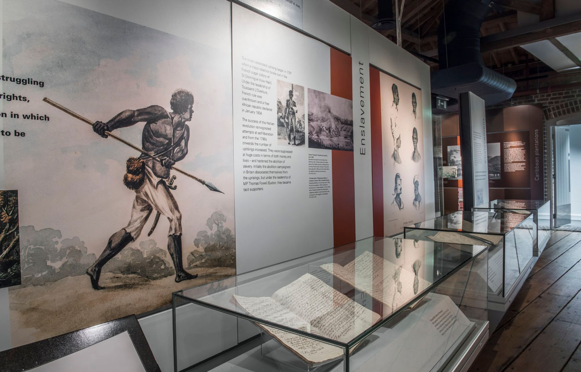 Installation view of the London, Sugar, Slavery exhibition at the Museum of London, Docklands, outside which Isaiah Ogundele protested the display of the Benin Bronzes © Museum of London