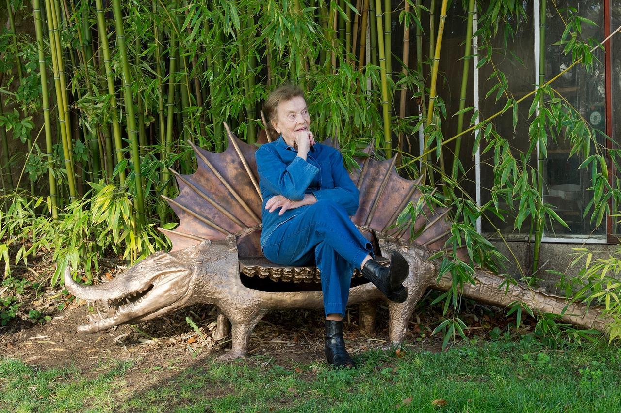 Claude Lalanne sitting on one of her Crocodile benches Photo: ©Luc Castel