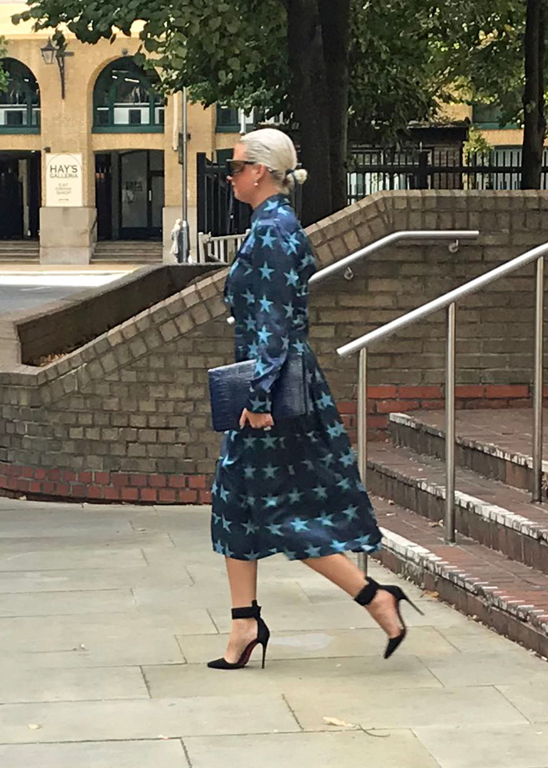 Angela Gulbenkian leaving a London court in September after denying theft charges in the sale of a Kusama pumpkin. The German dealer now faces similar charges in a Munich court over a Warhol print sale to a London dealer. Central News