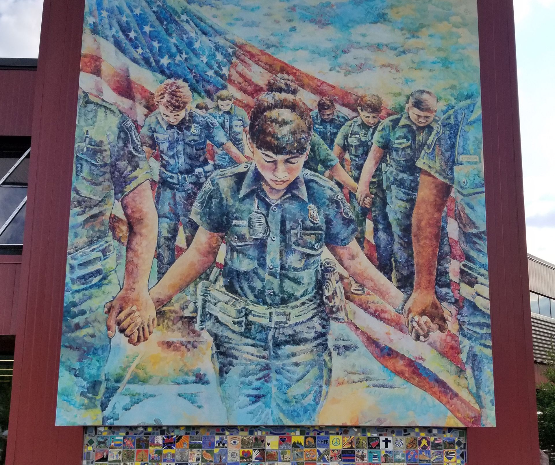 A mural honouring the police in Sterling Heights, Michigan is accompanied by rows of tiles created by officers and their families Courtesy of Sterling Heights City Hall