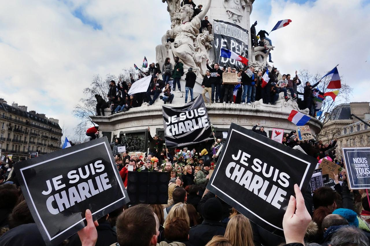 People in Paris gathered in support of the victims of the Charlie Hebdo shooting in 2015 Photo: Olivier Ortelpa