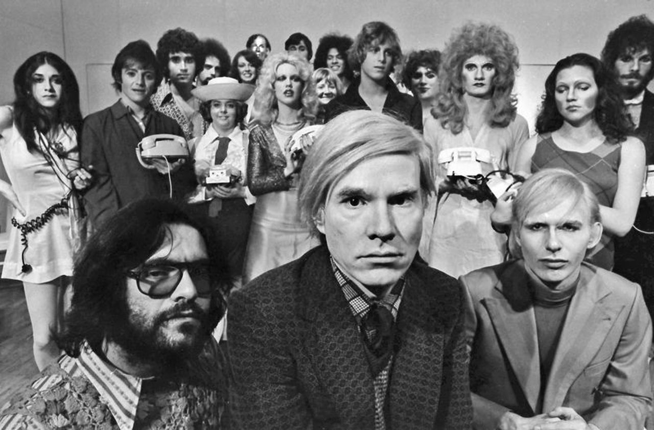"""Andy Warhol with the cast of his play """"Pork"""" at La Mama, May 1971 Courtesy Jack Mitchell Archives"""