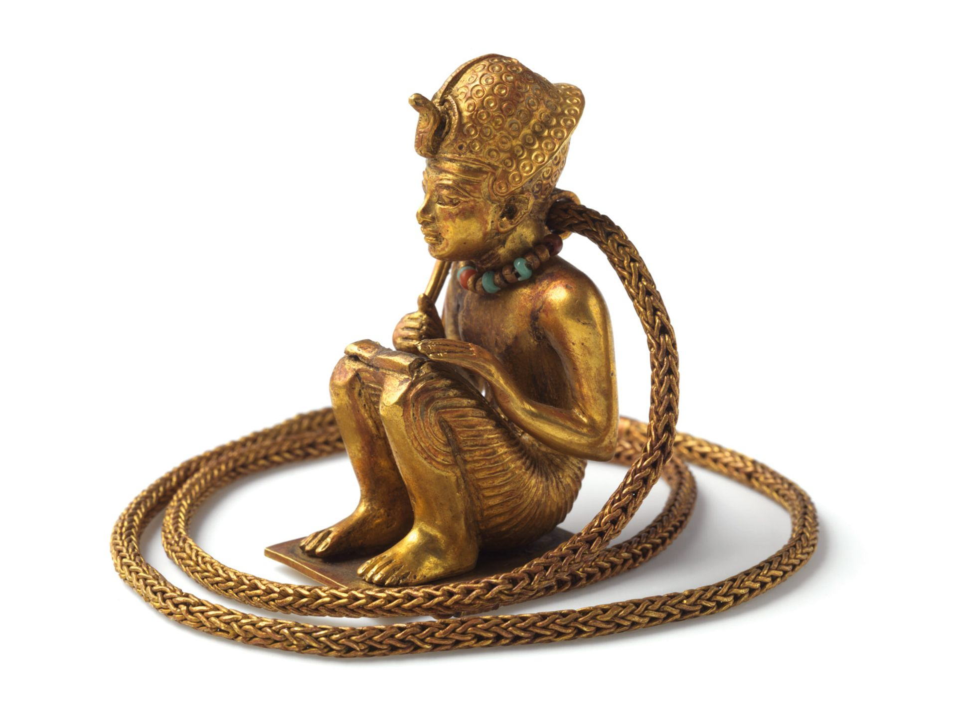 This gold squatting figure (1336-1326BC) with chain was previously thought to be a depiction of Amenhotep III © Brooklyn Museum