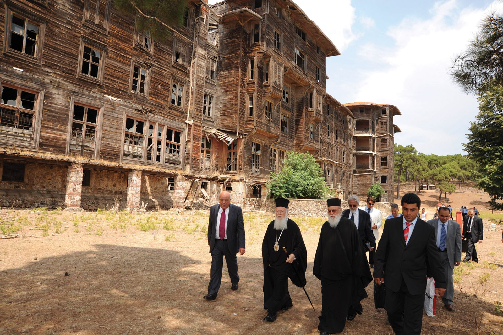 A group including the spiritual leader of Orthodox Christians, Patriarch Bartholomew, visits the dilapidated Prinkipo Orphanage. Turkey was ordered to return the site to the Ecumenical Patriarchate in a 2010 ruling by the European Court of Human Rights Photo: Nikolaos Manginas