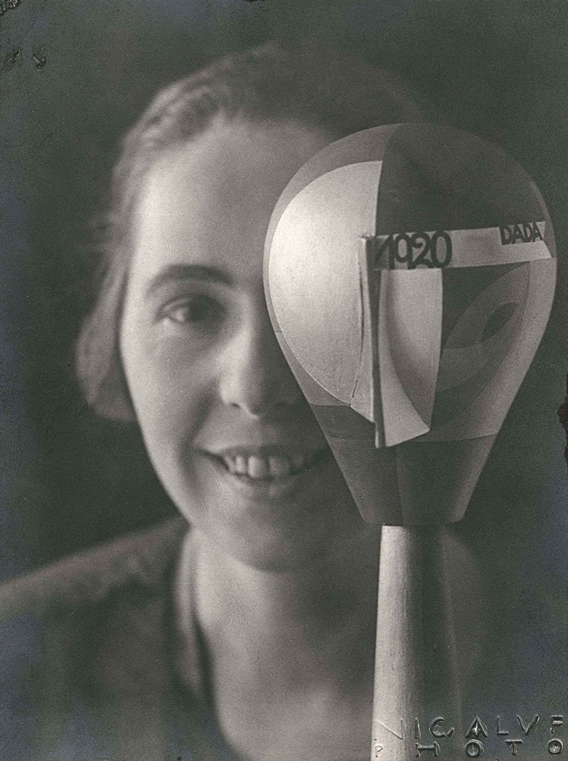 Sophie Taeuber-Arp with her Dada head sculpture, photographed by Nicolai Aluf in 1920 Stiftung Arp e.V., Berlin