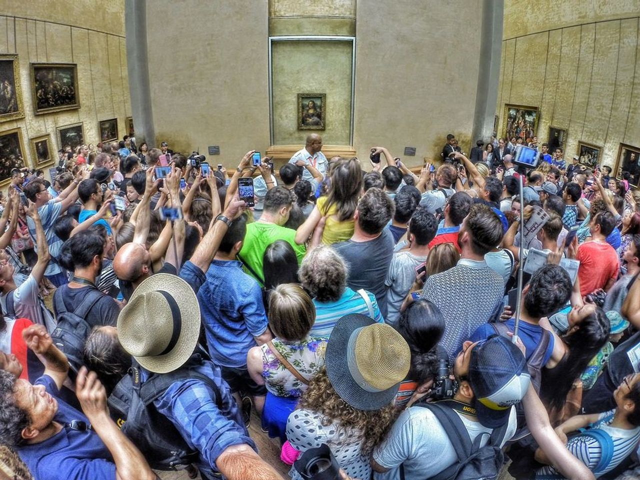 Packing them in? Crowds jostle to see the Mona Lisa at the Louvre Photo: Max Fercondini