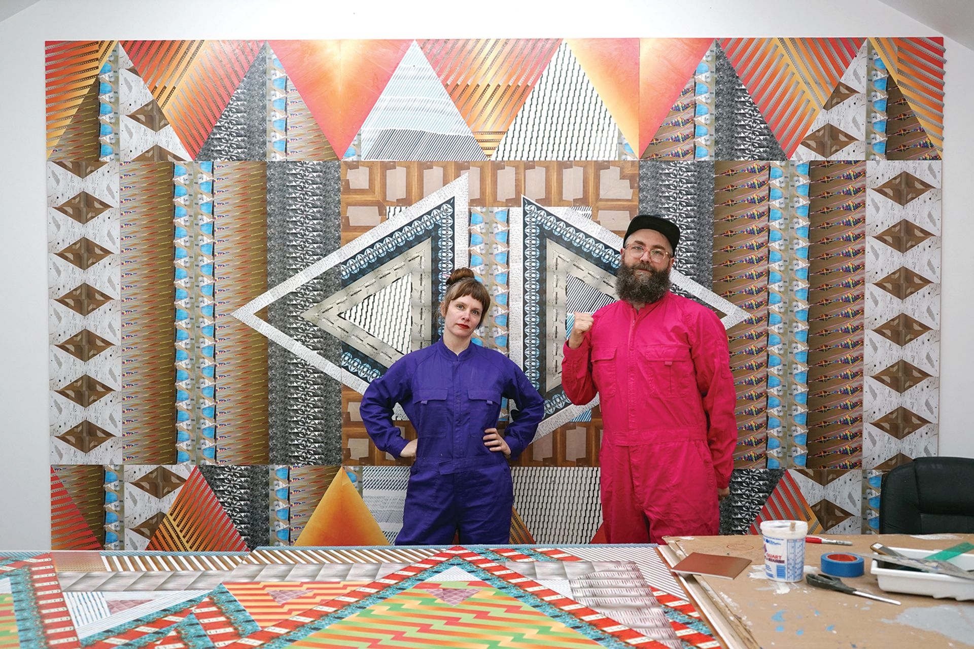Ghost of a Dream artist duo, Lauren Was and Adam Eckstrom, preparing their site-specific installation, Yesterday Is Here in the lobby of Boston's MassArt Art Museum Courtesy of MassArt