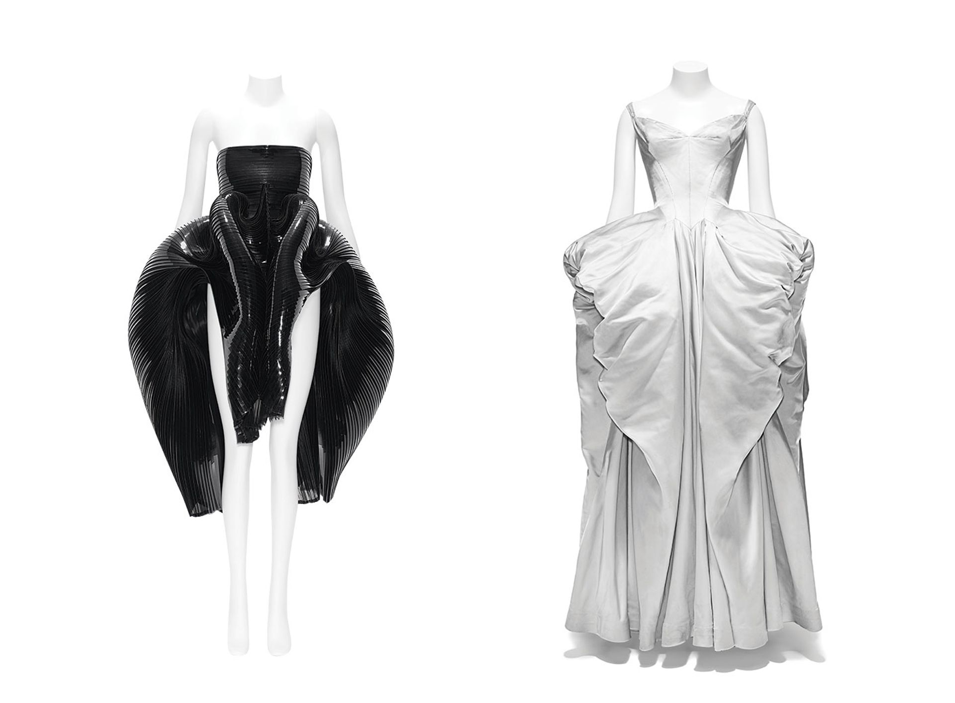 A PVC dress by the Dutch designer Iris Van Herpen (Autumn/Winter 2012-13) is shown alongside a 1950s silk ball gown by Charles James in the Met's Costume Institute show About Time