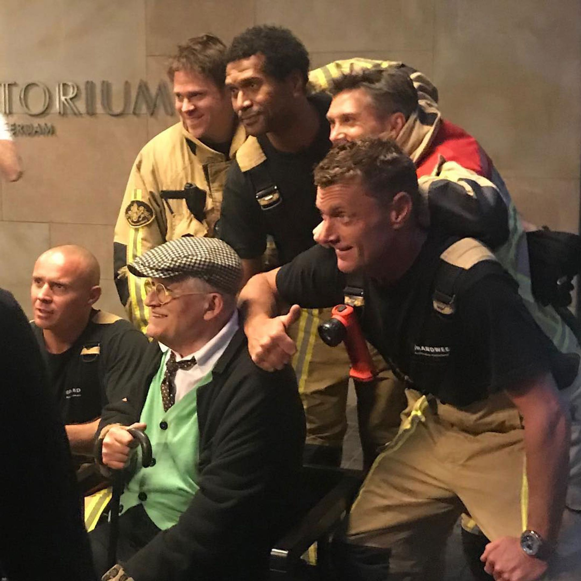 David Hockney with the Dutch firemen who rescued him from a lift in Amsterdam © davidelidawson/Instagram
