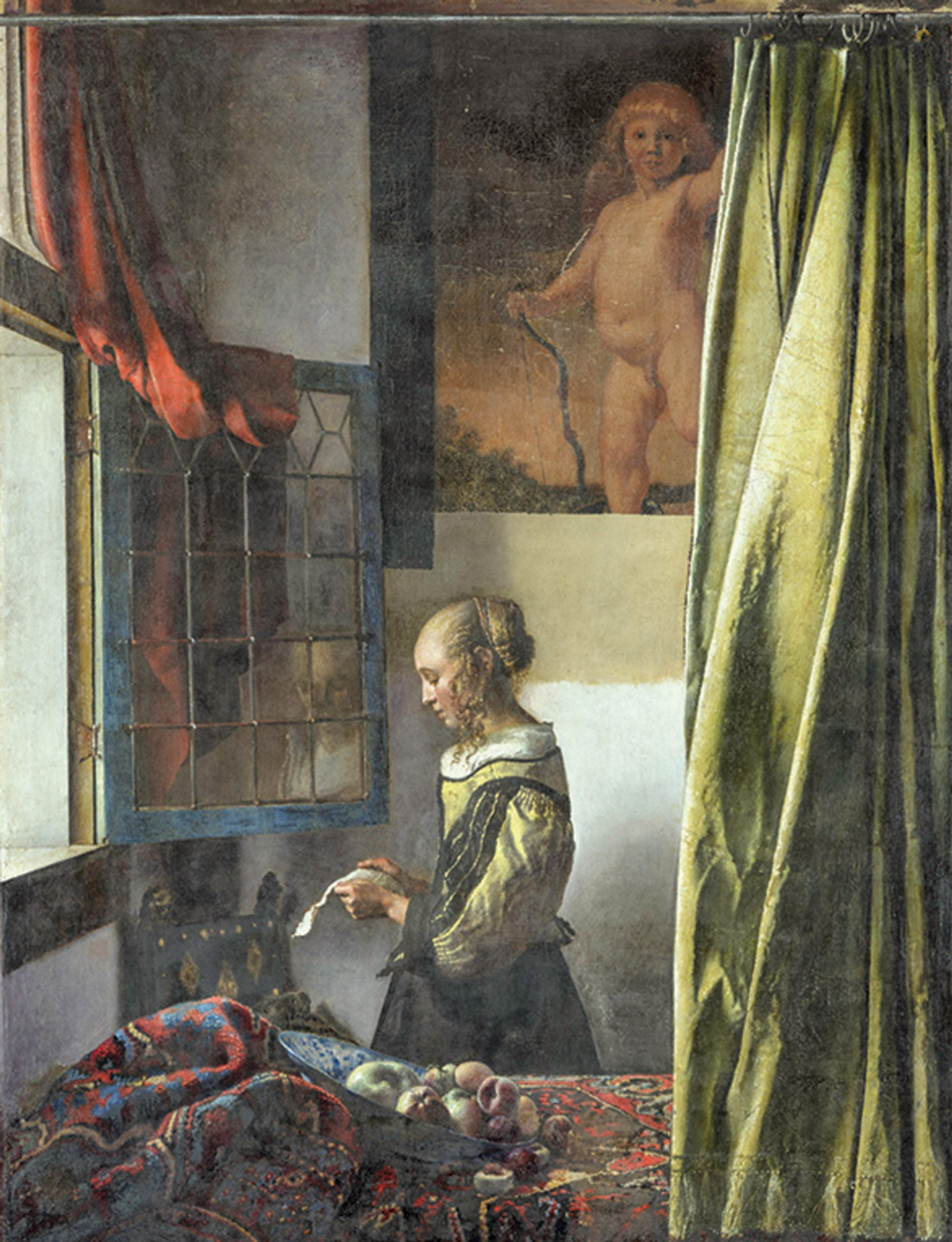 Vermeer's Girl Reading a Letter at an Open Window (1657-59) photographed during its four-year transformation, during which overpaint was removed from the back wall to reveal a picture of Cupid Photo: Wolfgang Kreische; © SKD