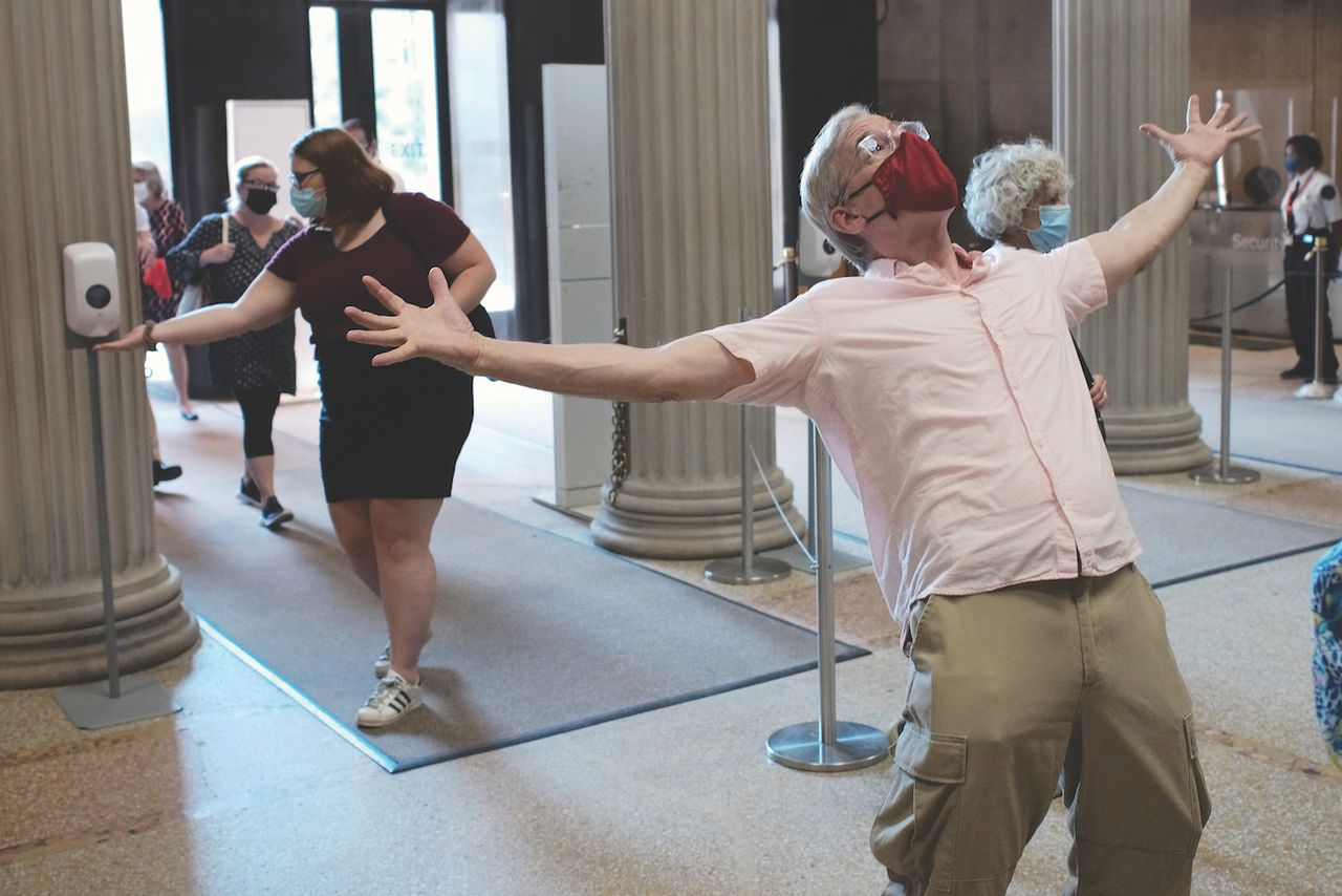 A visitor celebrates the reopening of the Metropolitan Museum in New York in August Taylor Hill/Getty Images