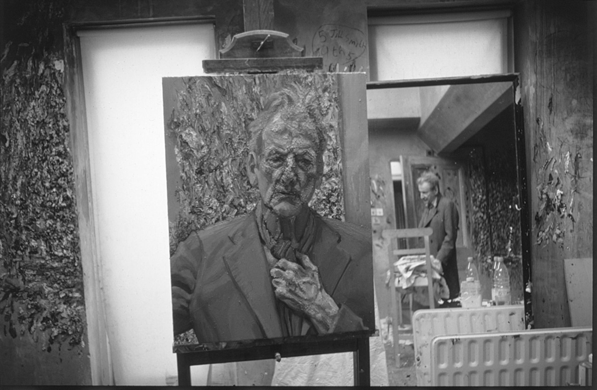 Lucian Freud's painting Self-portrait, Reflection (2002) with the artist reflected in a mirror in the background © William Feaver