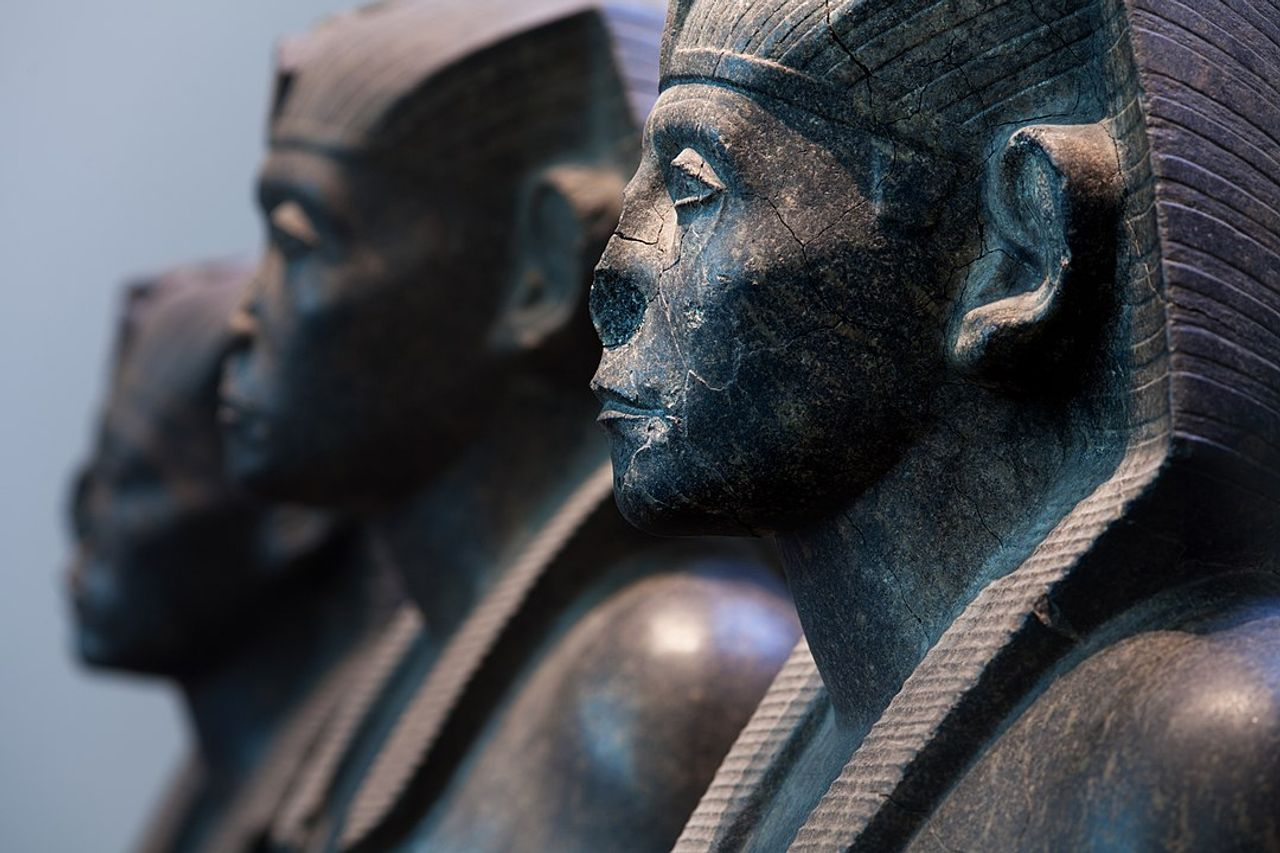 Three black granite statues of the pharaoh Senusret III, (around 1850 BC), in the collection of the British Museum, one of the many UK institutions that have been criticised for dragging their feet on colonial-era restitution © Jorge Ryan/CC