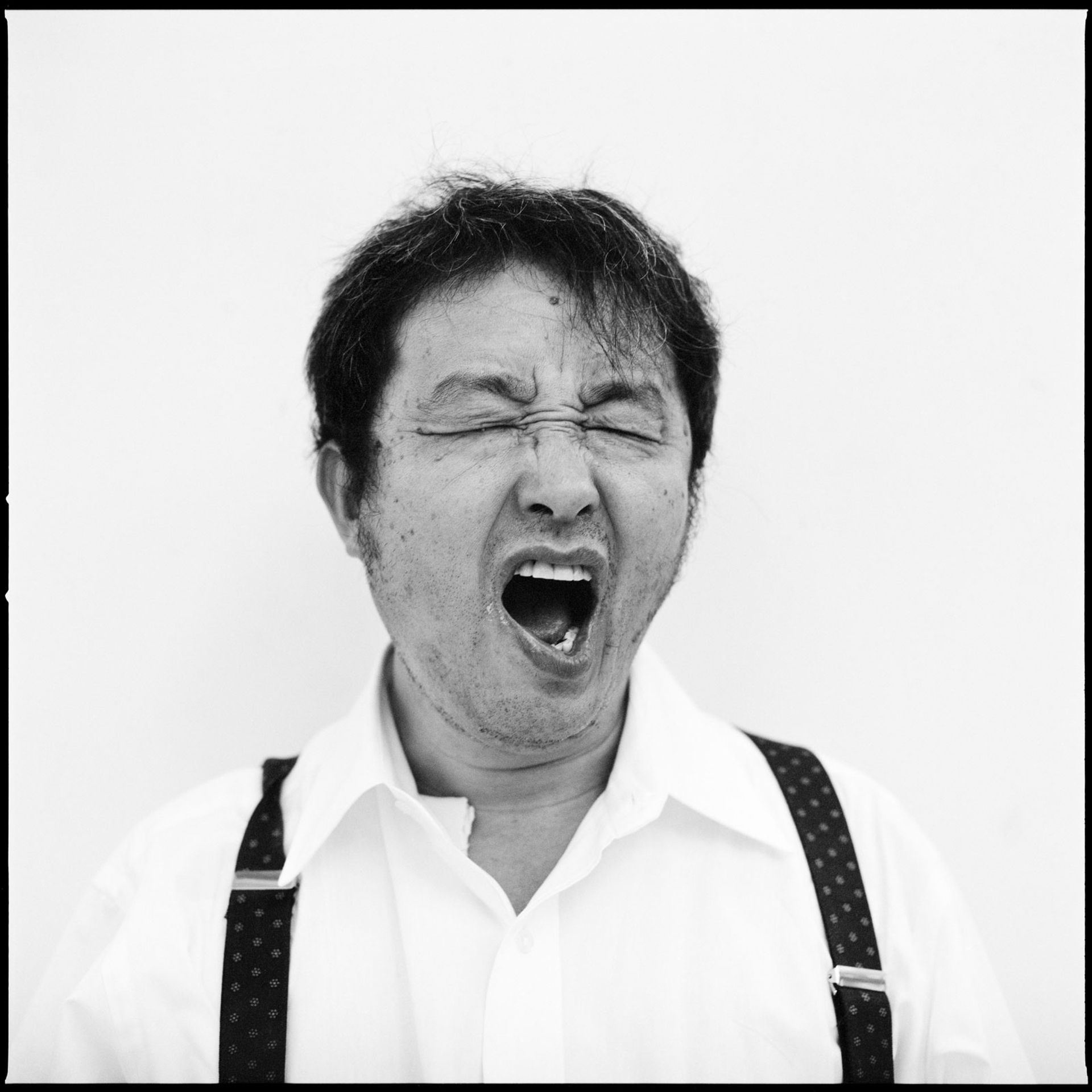Nam June Paik yawning, photographed in 1993 by Roman Mensing © Roman Mensing, artdoc.de