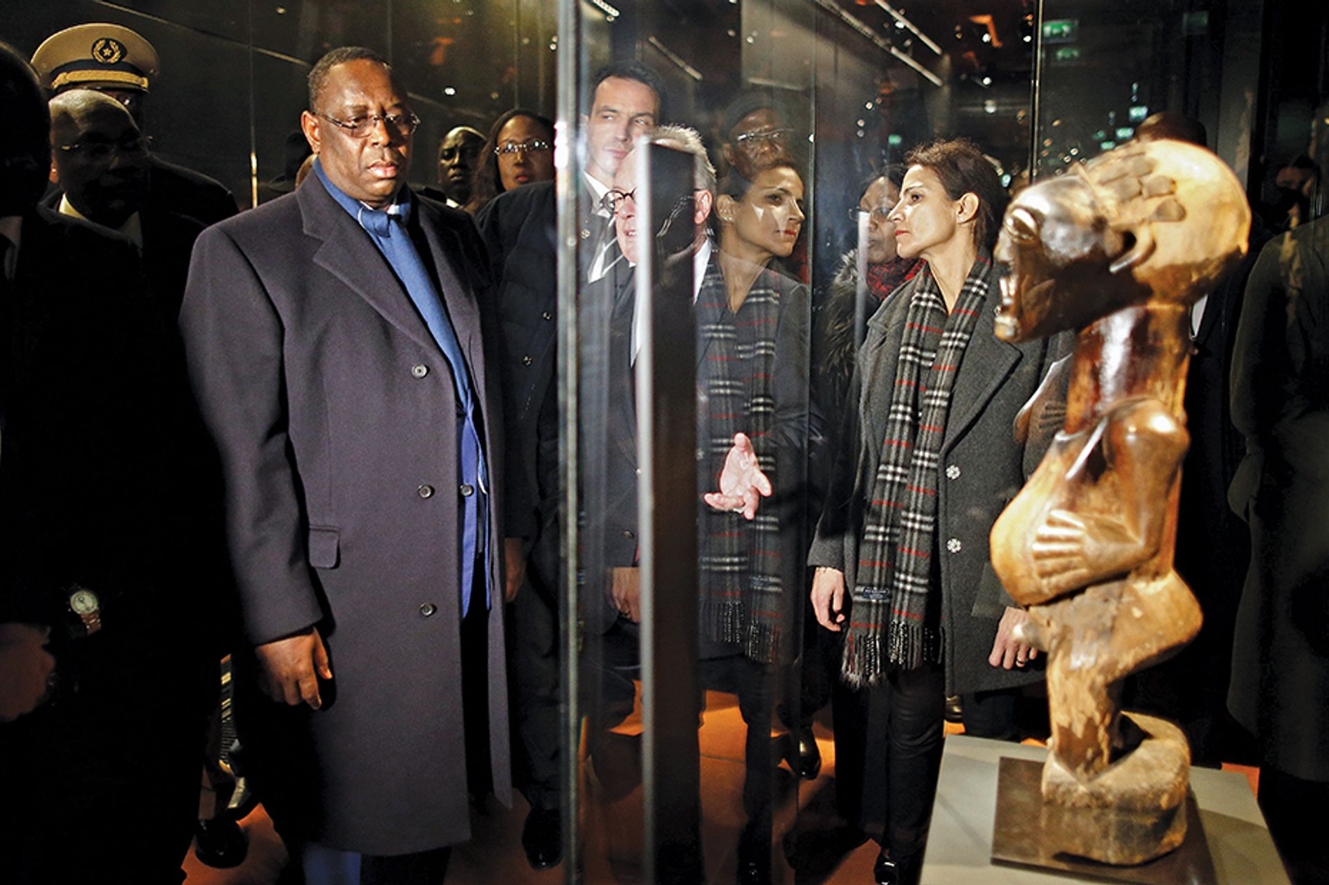The Senegalese president, Macky Sall, at the Musée du Quai Branly-Jacques Chirac museum in 2016. The country has said it wants the return of all objects from Senegal in French museums © Charles Platiau/AFP/Getty Images