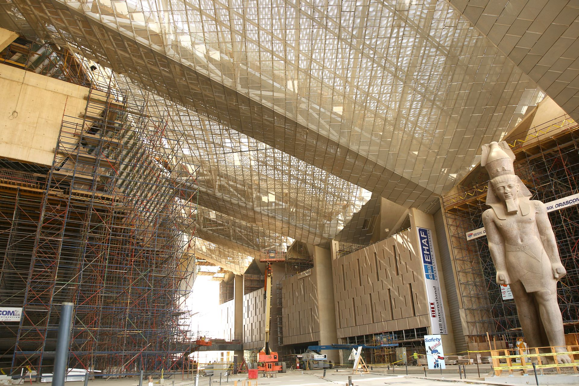 The soaring entrance hall of the Grand Egyptian Museum, where a 12m-tall, 83-ton granite statue of King Ramses II is already in place