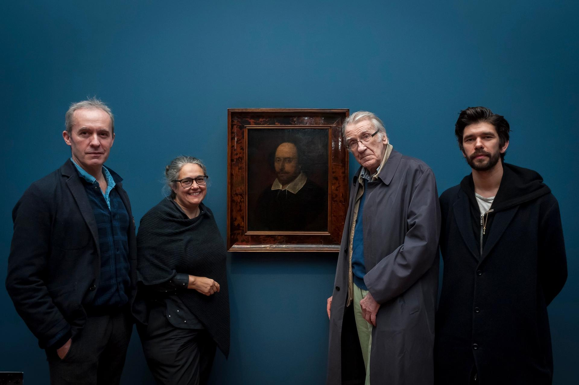 Stephen Dillane, Tacita Dean, David Warner and Ben Whishaw pose by a portrait of Shakespeare during a viewing of  Dean's new film portrait of the actors at the National Portrait Gallery on 13 March Jorge Herrera