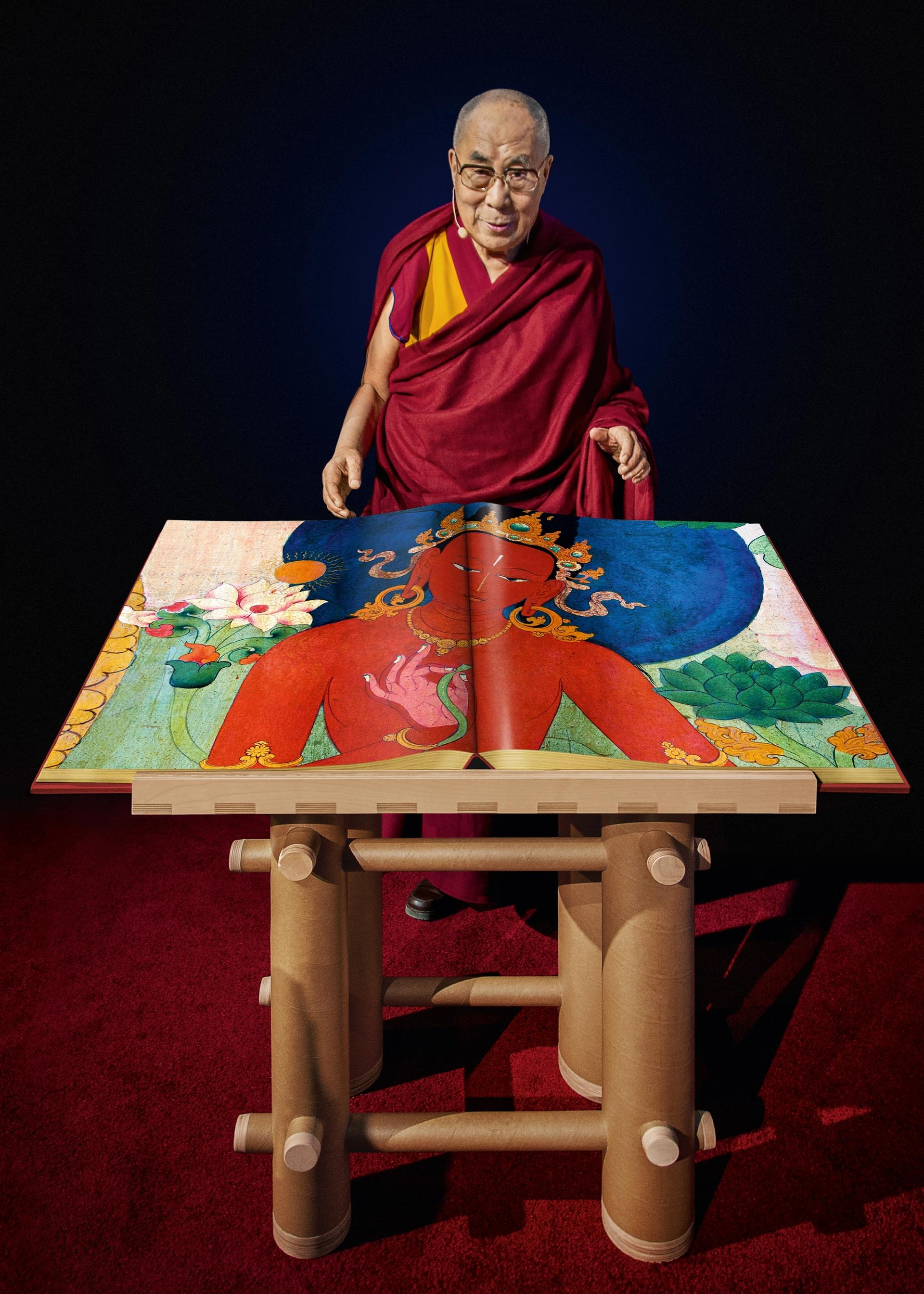 Tenzin Gyatso, the Fourteenth Dalai Lama, with a draft copy of Murals of Tibet Photo: Mina Magda © TASCHEN