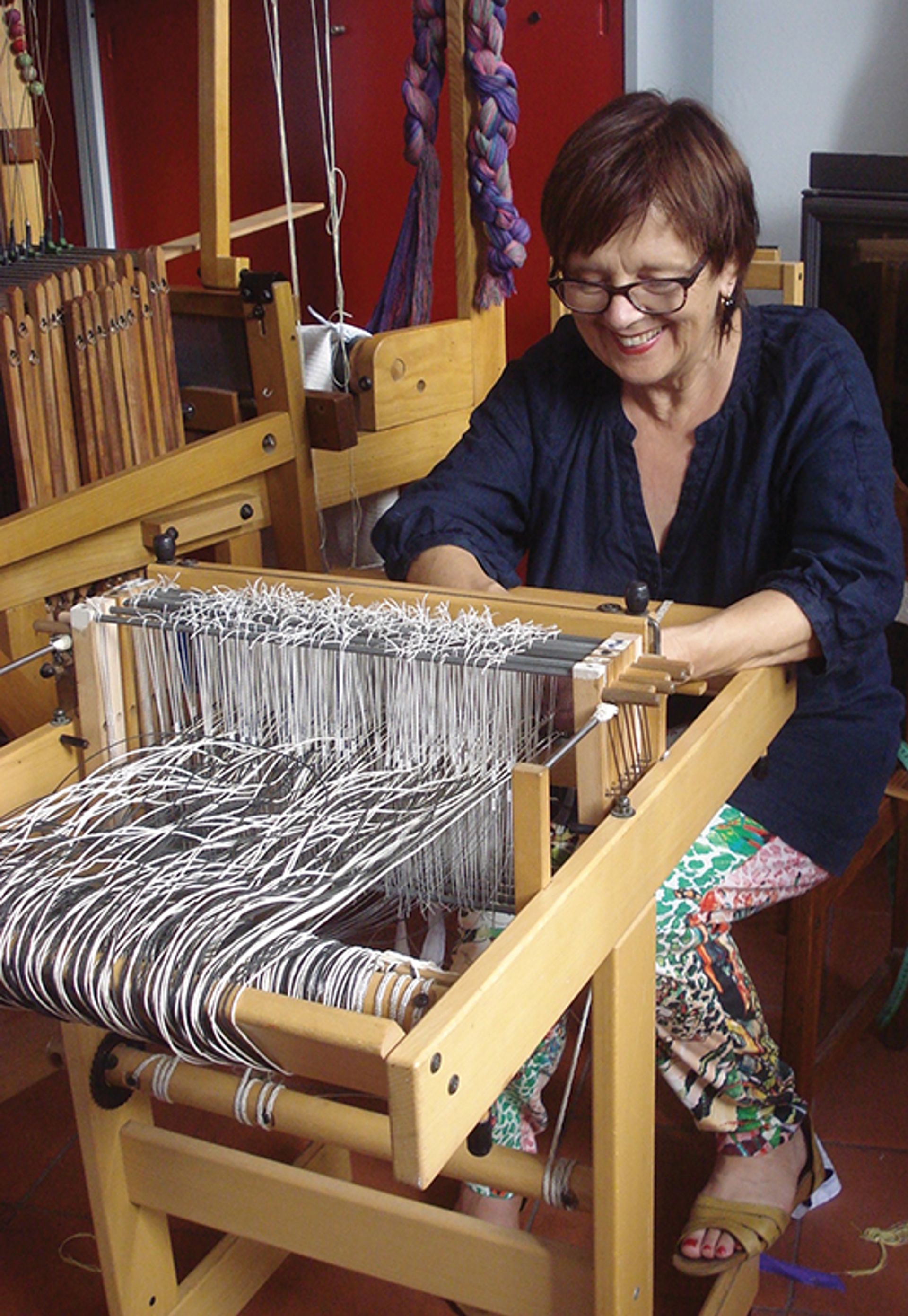 Helena Loermans works on a handloom at her studio in southern Portugal Courtesy of Helena Loermans