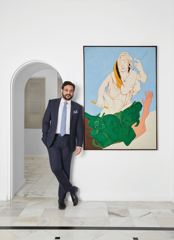 Gaurav Bhatia, the managing director of Sotheby's India, with Tyeb Mehta's Durga Mahisasura Mardini Photo: IANS