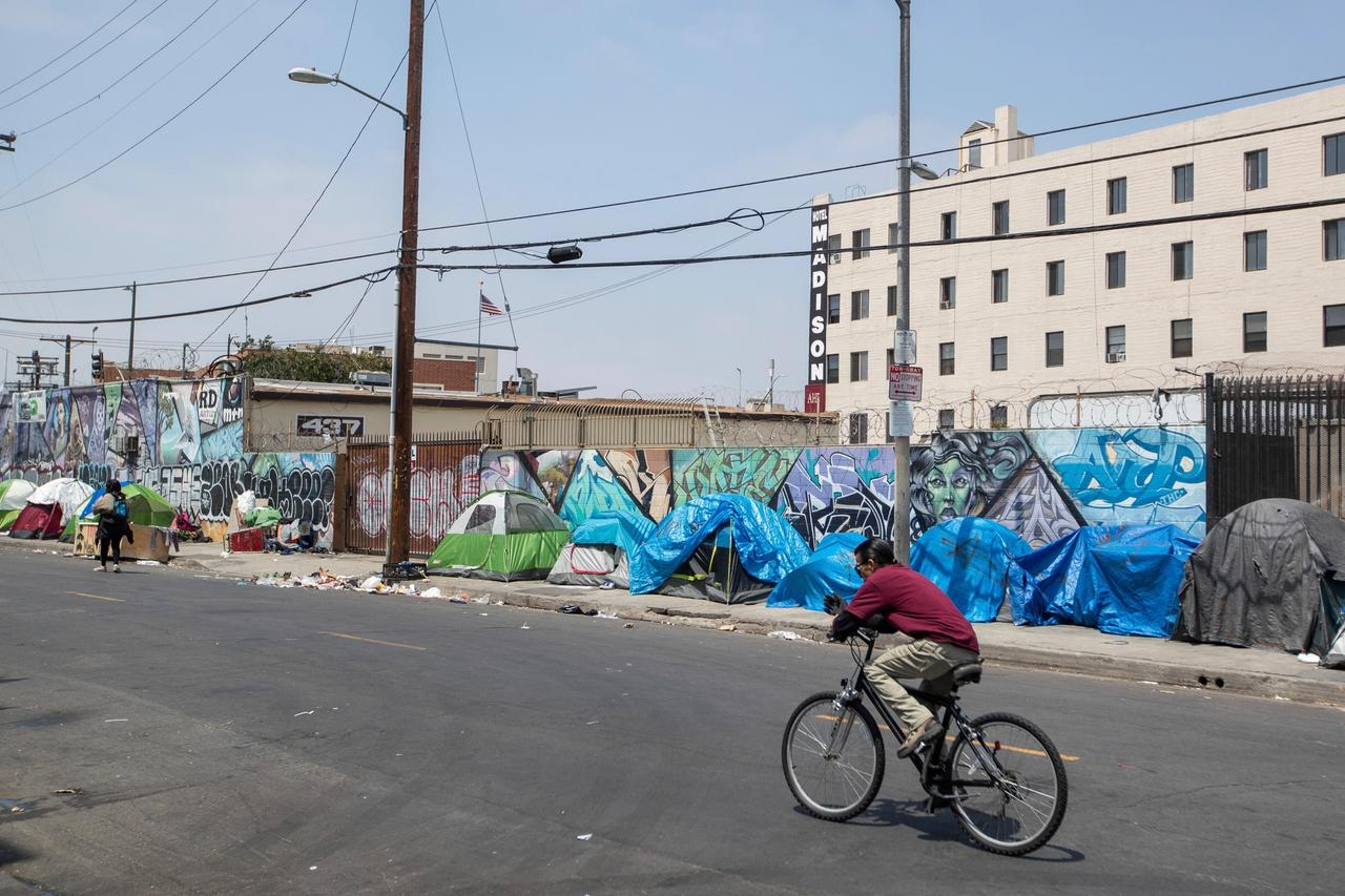 A community of homeless people living in tents line a Skid Row street in Downtown Los Angeles Jeff Lewis/AP Images for AIDS Healthcare Foundation