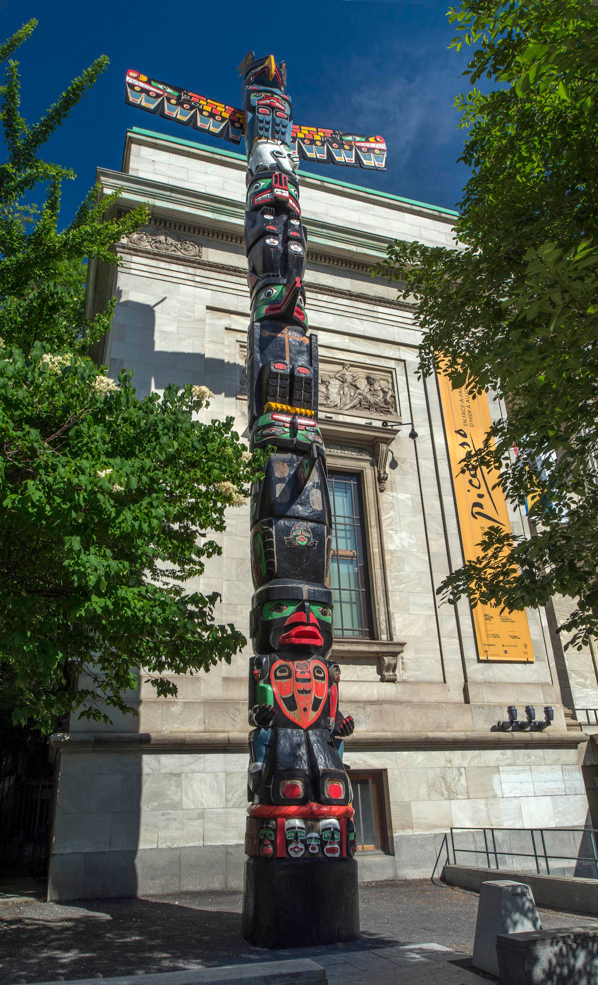 Charles Joseph's Residential School Totem Pole (2014–16) before the left hand on the lower portion of the work was stolen Courtesy of the The Montreal Museum of Fine Arts