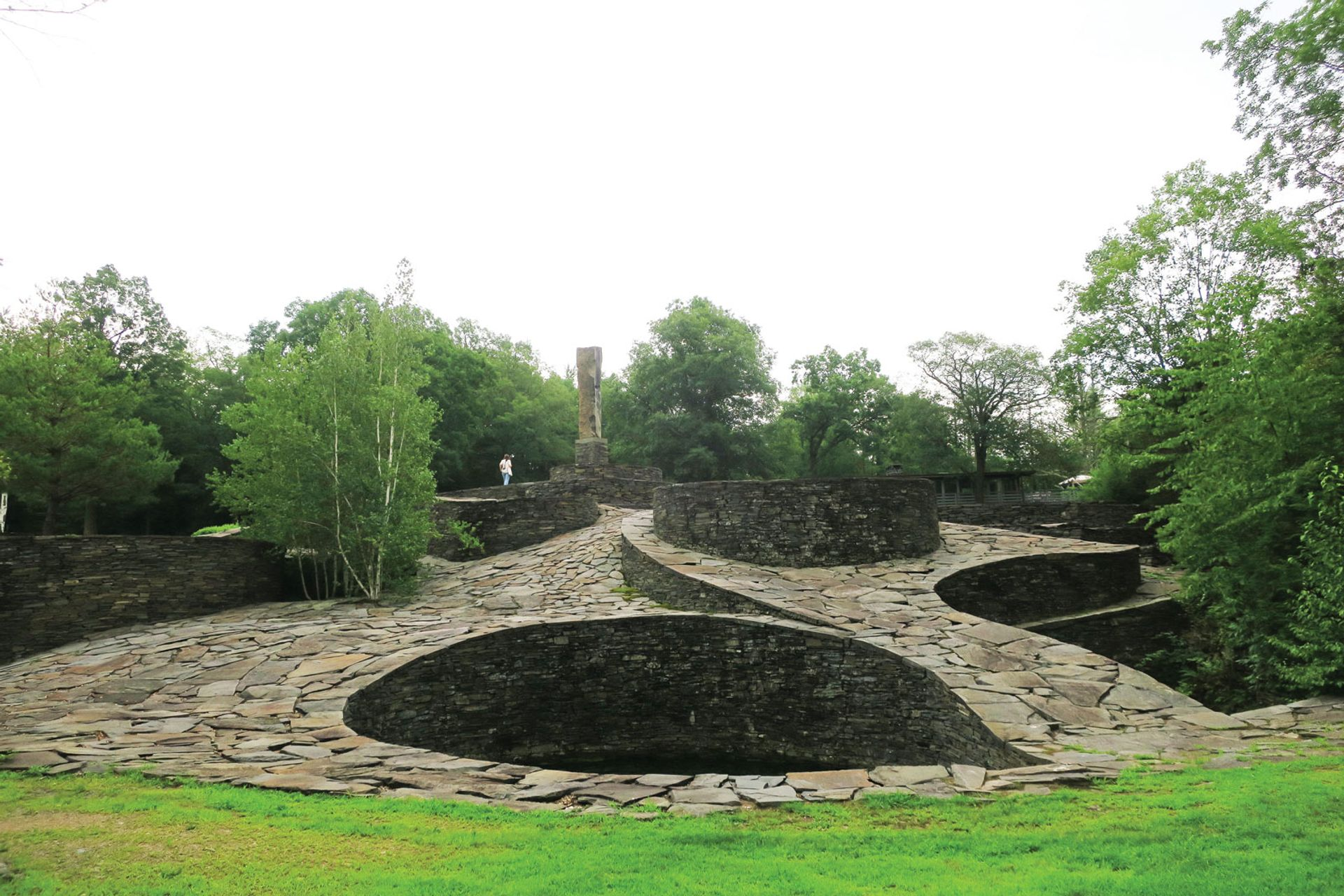 Harvey Fite set about hand placing stones at Opus 40, weaving them together like a jigsaw puzzle that rises into an undulating, built landscape Photo: Manuela Michailescu