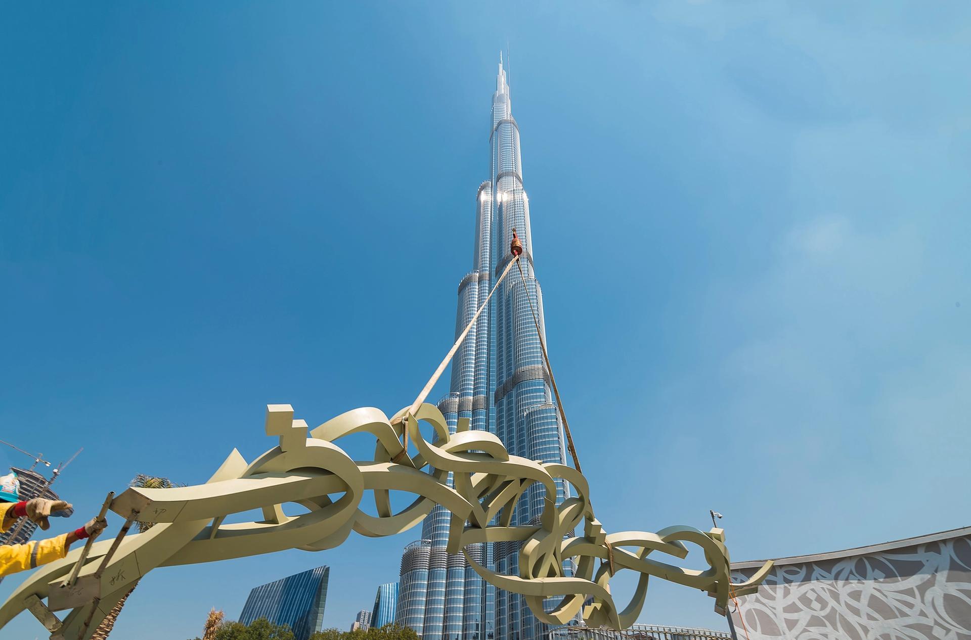 eL Seed's new works in front of the Burj Khalifa in Dubai Christina Dimitrova. Courtesy of eL Seed studio