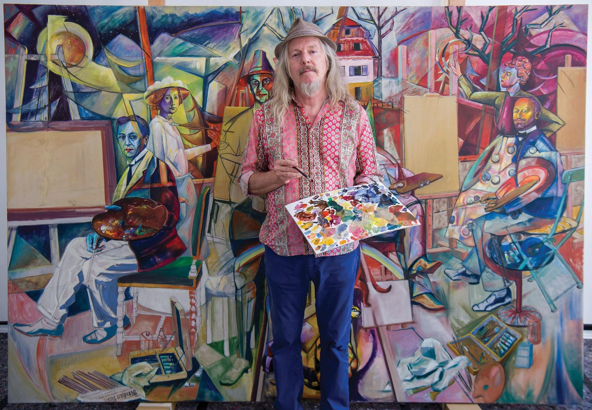 The painter Wolfgang Beltracchi stands in front Gruppenbild der blauen Reiter (group picture of the blue riders), a painting he is working on in Munich, Germany, 24 August 2017 Photo: Peter Kneffel/dpa/Alamy Live News