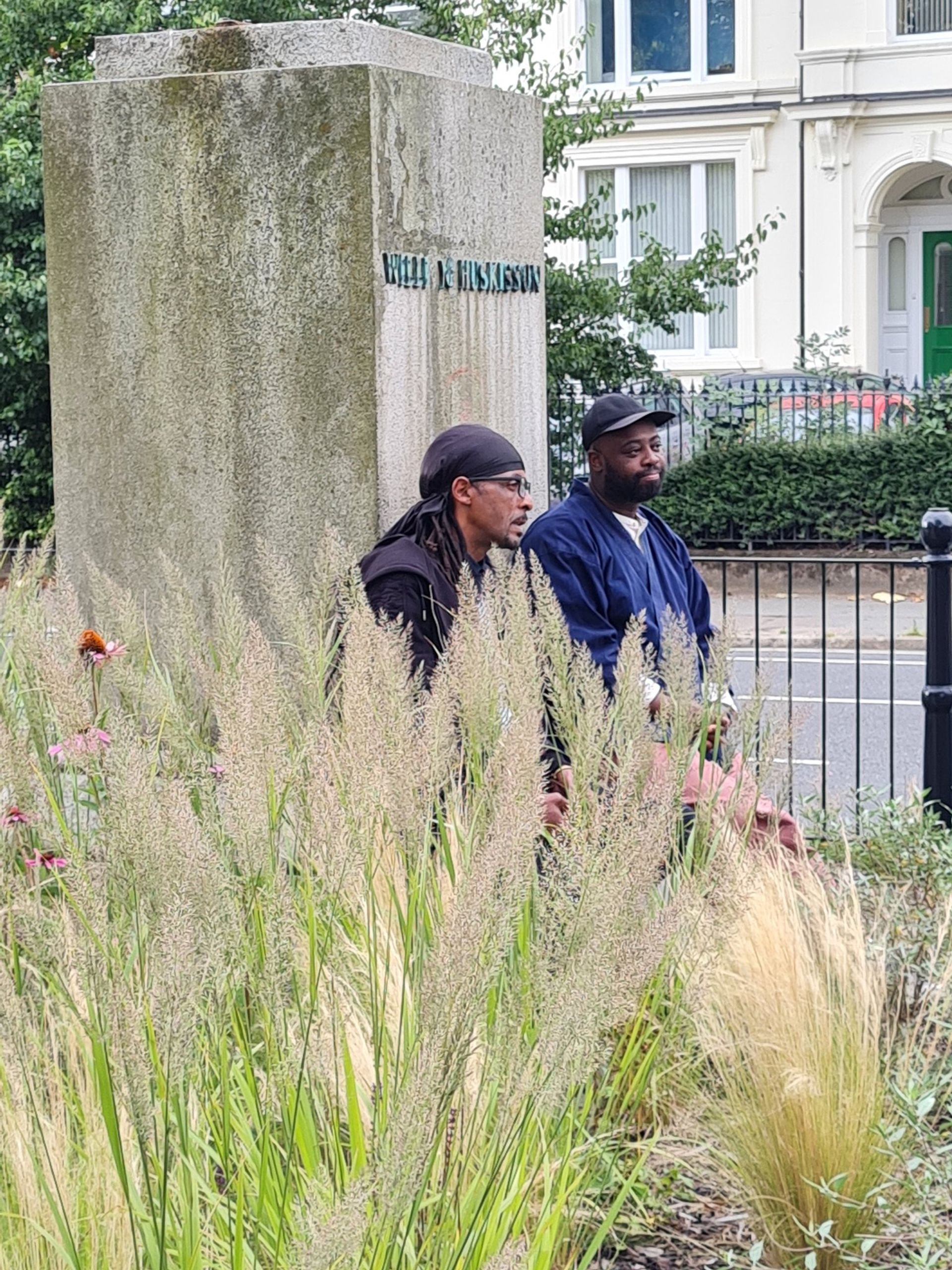 Harold Offeh (right) with his sound installation at the plinth of the toppled statue of William Huskisson Courtesy Twitter / Sonia Bassey
