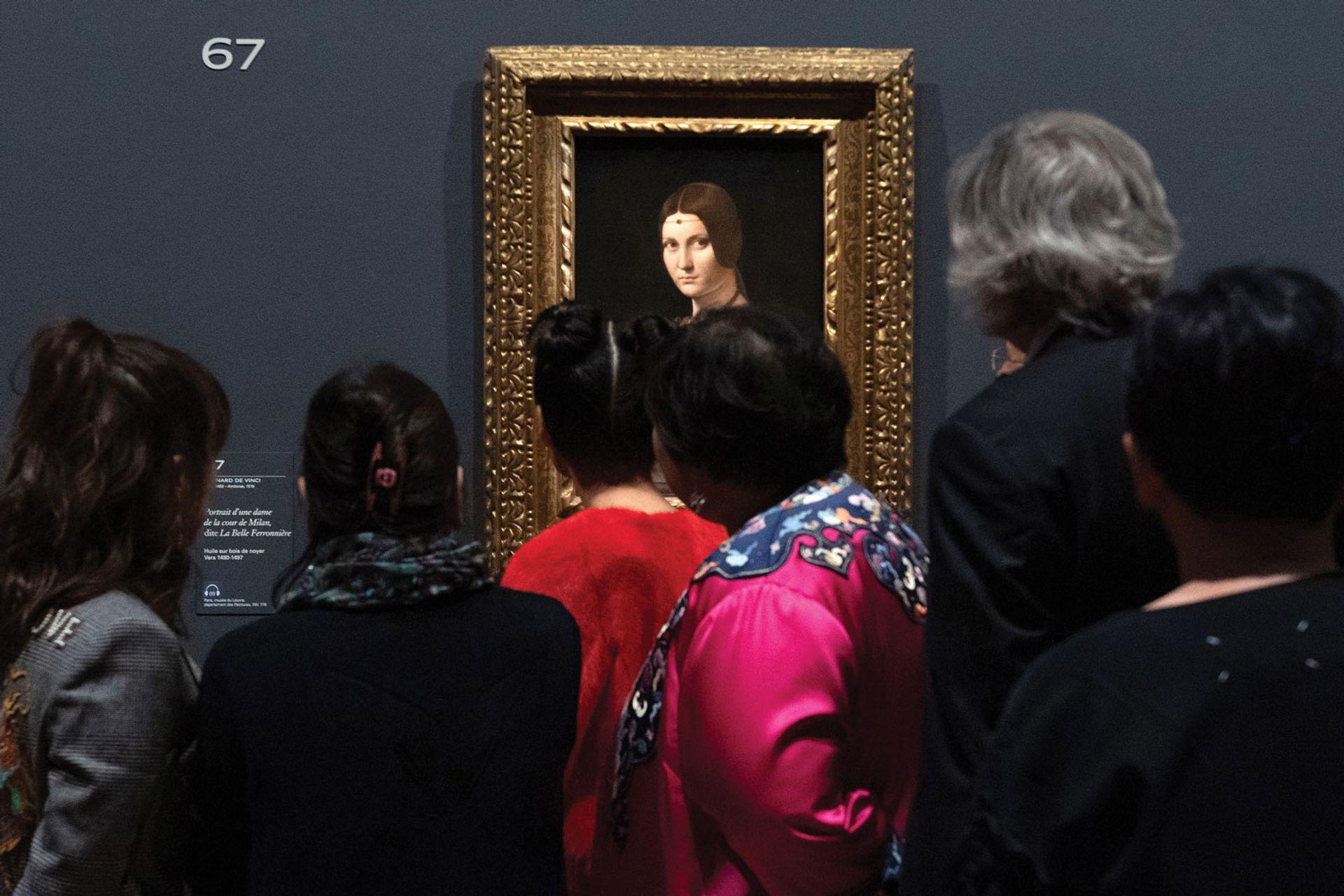Visitors admire La Belle Ferronnière at the Louvre show Photo: Aurore Marechal/ABACA/PA Images