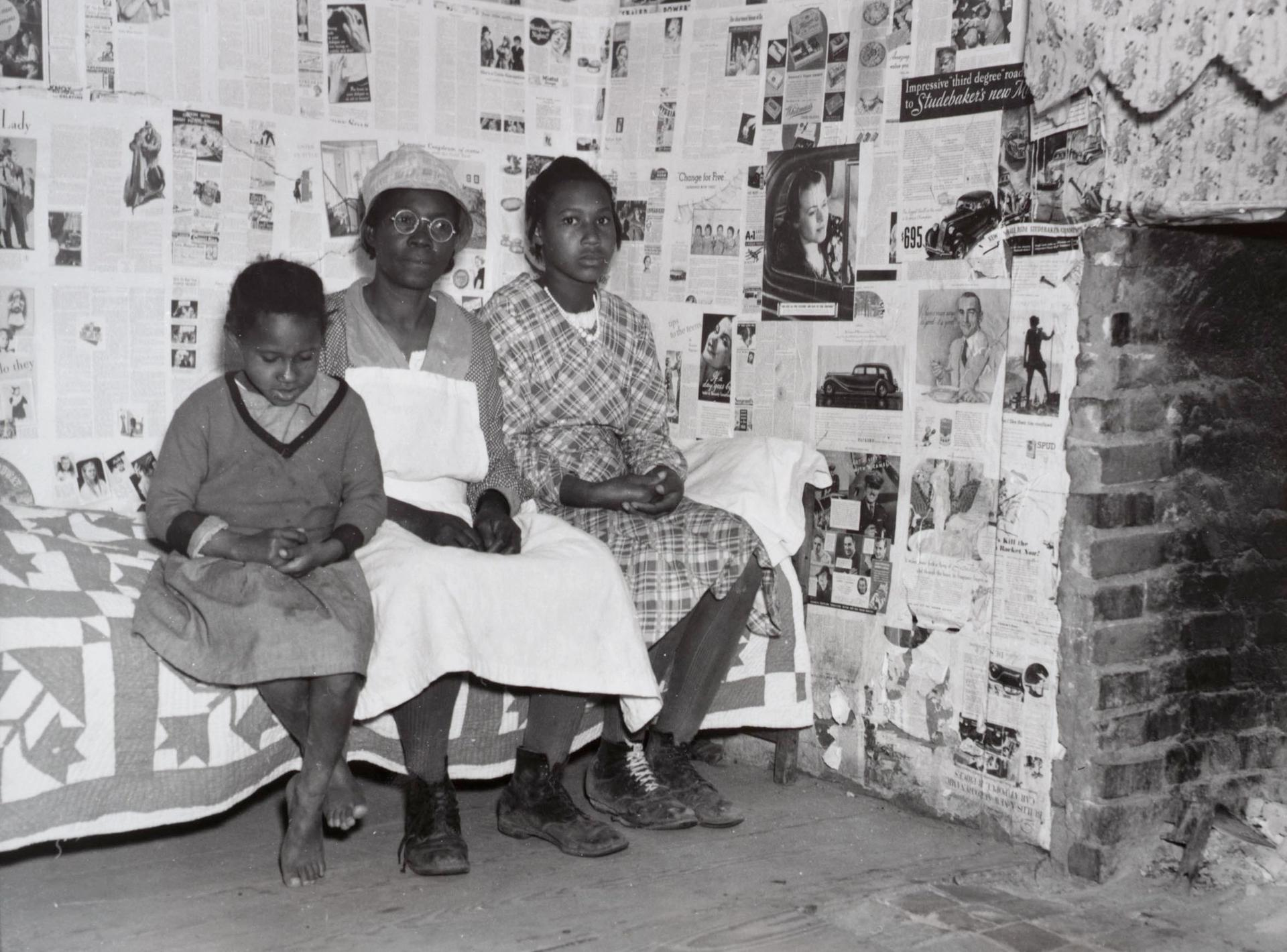 Gee's Bend artist Lucy Mooney and granddaughters Lucy P. Pettway and Bertha Pettway on a bed in Lucy's house, Gee's Bend, Alabama, 1937 Arthur Rothstein. Farm Security Administration/Office of War Information Collection, Prints and Photographs Division, Library of Congress.