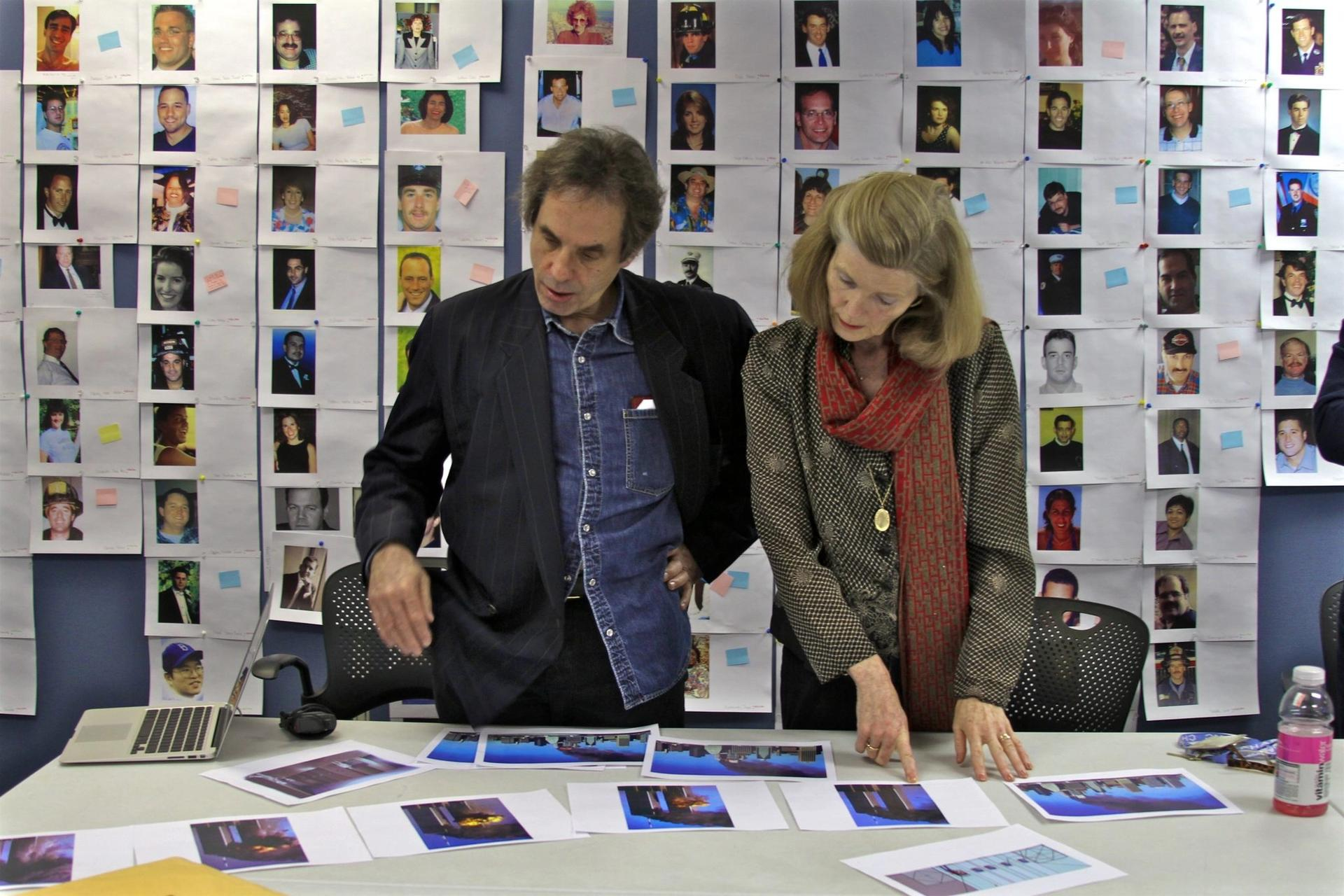 Michael Shulan, Creative Director, and Jan Seidler Ramirez/ Chief Curator & Director of Collections, Nation September 11th Memorial and Museum, reviews photographs of victims that will be included in the Memorial