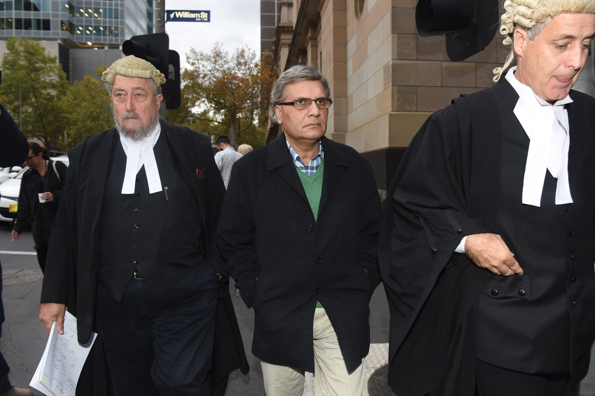 Art restorer Mohamed Aman Siddique (centre), pictured in May 2016 leaving the Victorian Supreme Court in Melbourne, where he was found guilty of art fraud, but later acquitted © TRACEY NEARMY/AAP Image