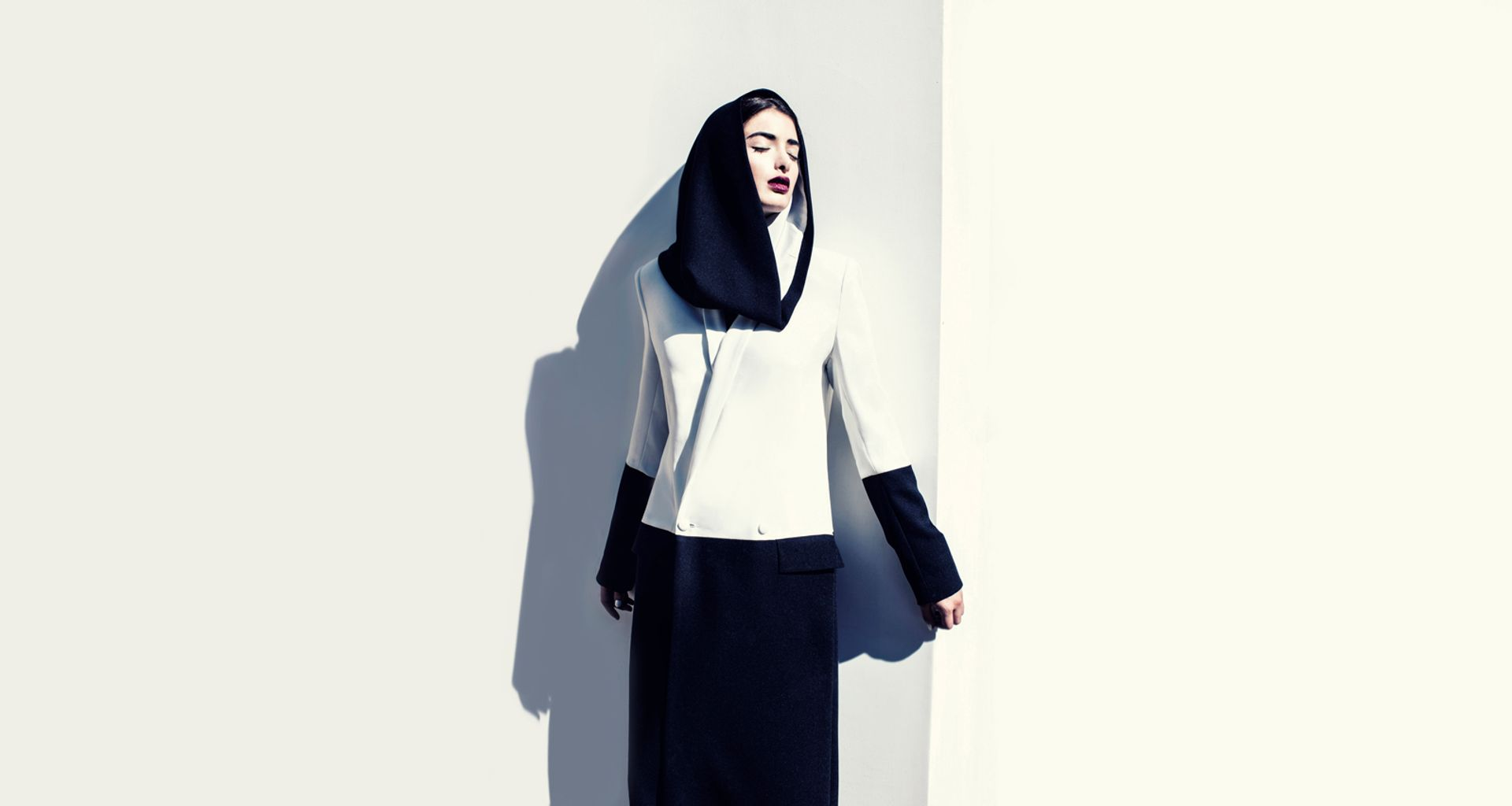 This two-toned crepe hood (2014) by Faiza Bouguessa is one of 80 garments on show Courtesy of Faiza Bouguessa