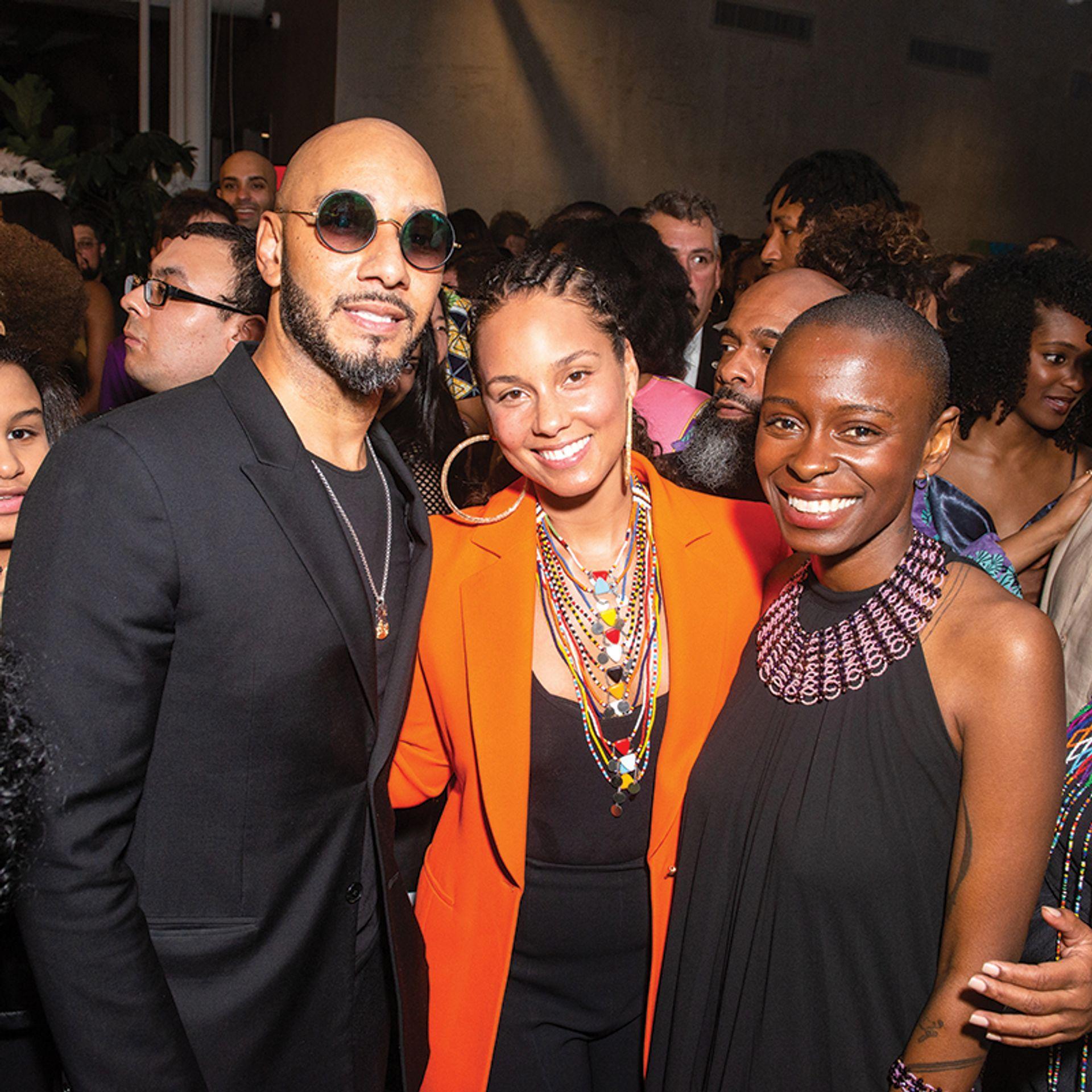 The musical couple Swizz Beatz and Alicia Keys  (left) with  Rees Visionary Award-winning artist Toyin Ojih Odutola Madison McGaw/BFA.com