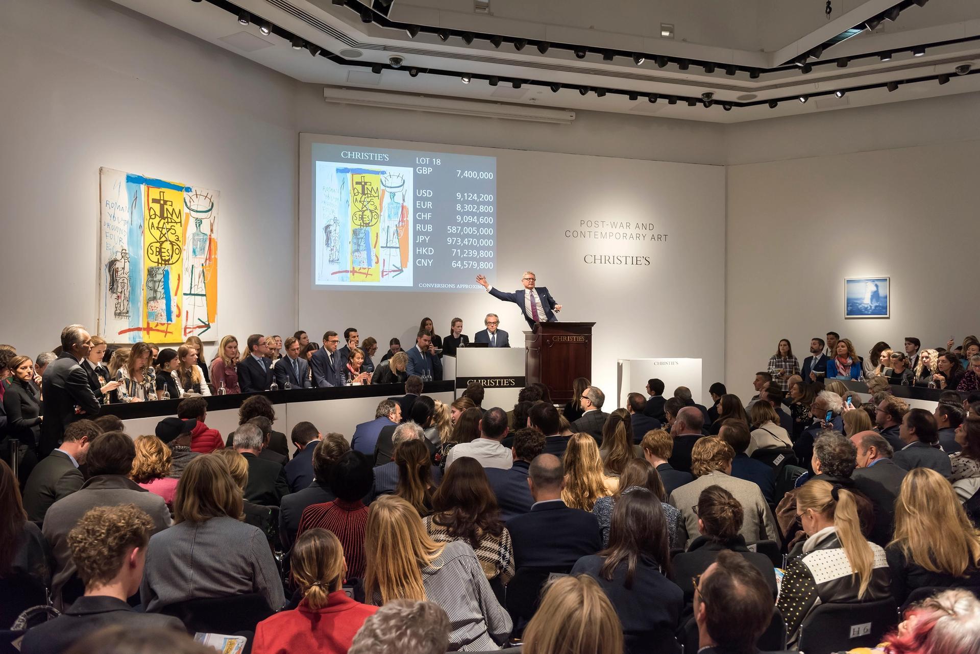 Christie's auctioneer Jussi Pylkkänen sells Jean-Michel Basquiat's Four Big (1982) Courtesy of Christie's