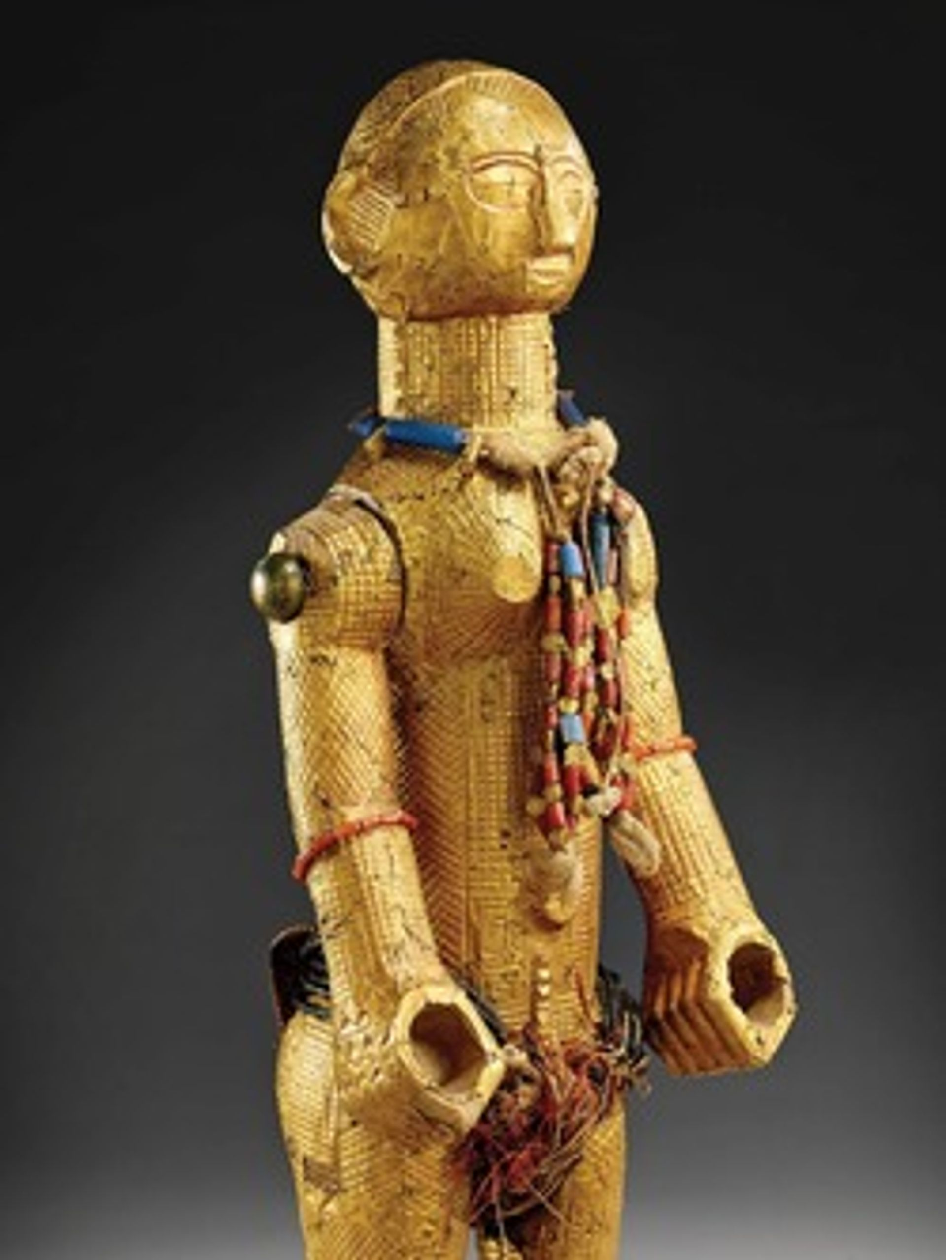 This 19th-century female figure from the current-day Ivory Coast is made of wood, gold, brass, coral, glass, coconut, vegetable fibres and cotton (© Musée du quai Branly - Jacques Chirac, photo Claude Germain)